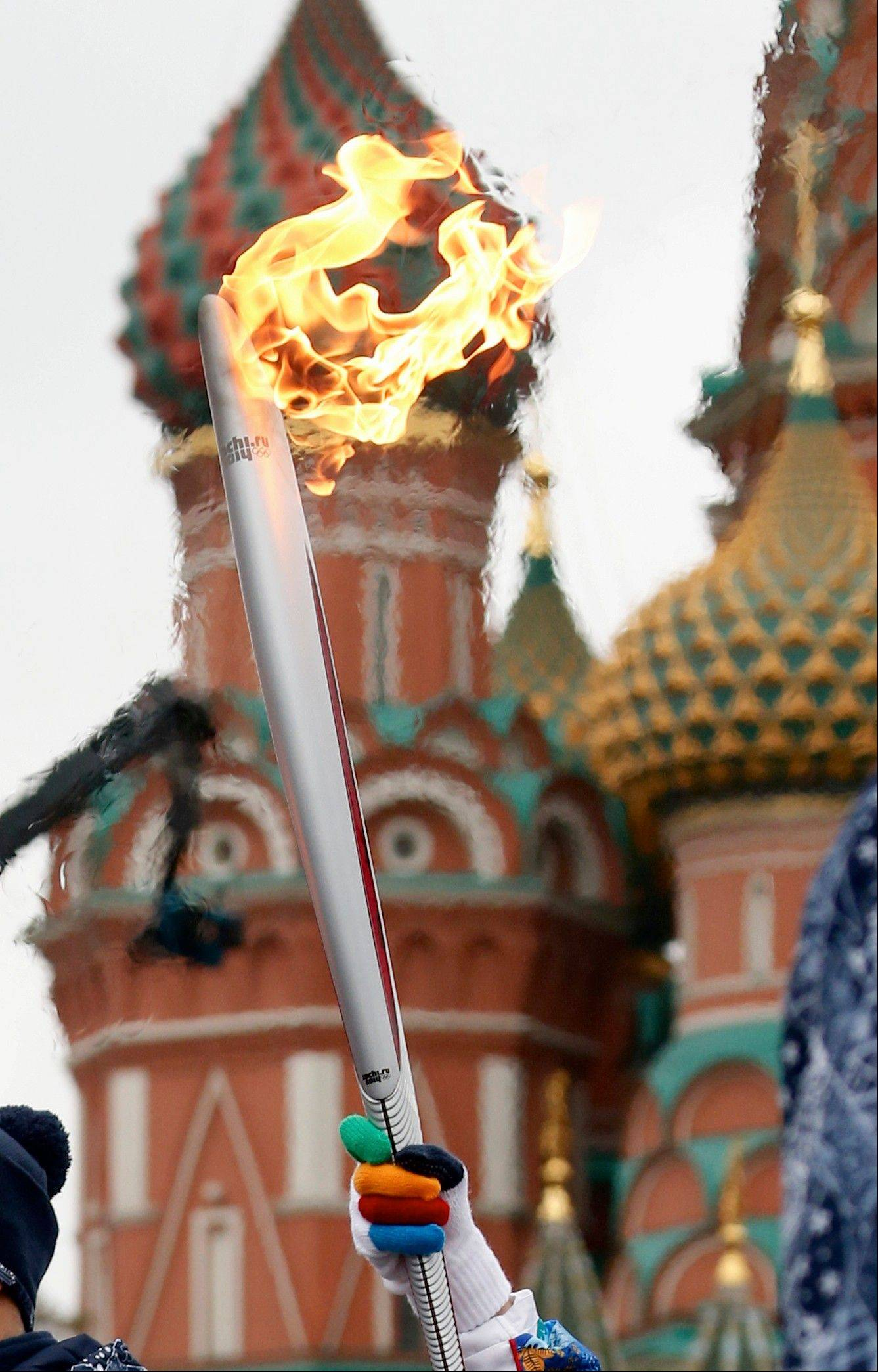 Former gymnast Svetlana Khorkina holds a torch during a relay of the Olympic flame on Monday in Moscow.