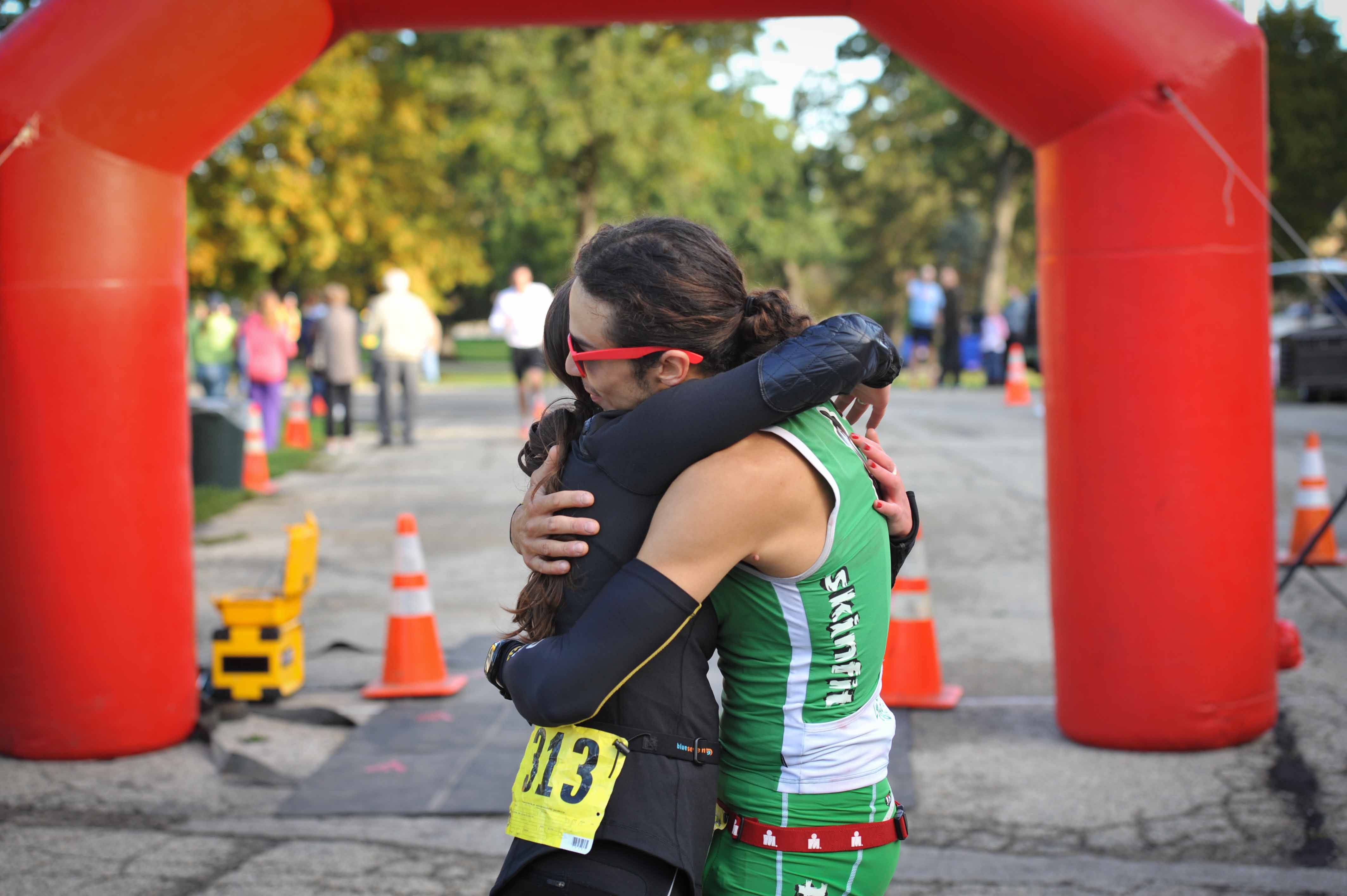 2nd Place Co-Ed Duathlon Team of Mollly Hillig and Christopher Rodriguez embrace at the Finish Line of the Run and Roll for the Dole that took place in Crystal Lake, IL on Sunday, October 6, 2013.