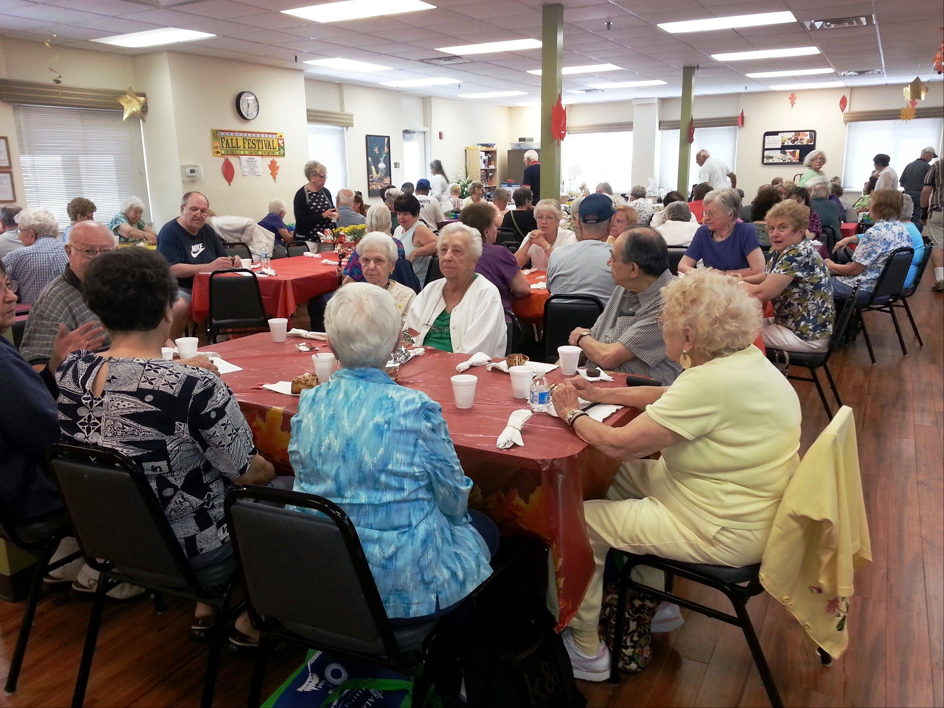 "More than 70 people stayed for lunch at the ""Our Place Cafe"" and enjoyed the laughs and magic performed by Dennis DeBondt."