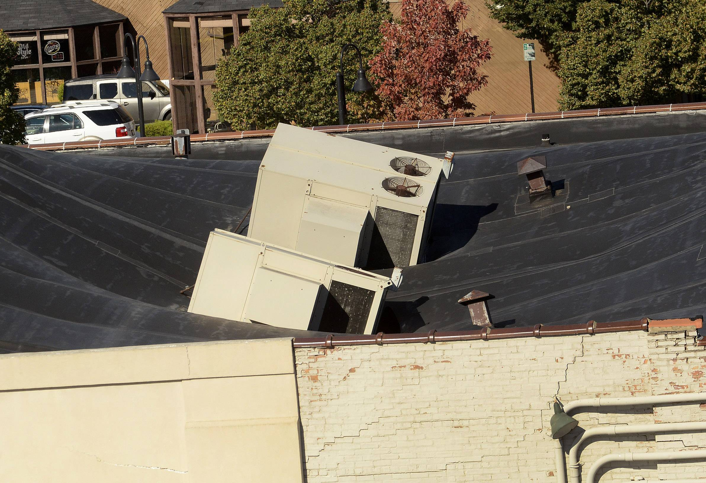 Two air-conditioning units sink into the roof of Tri-State Electronics in Mount Prospect.