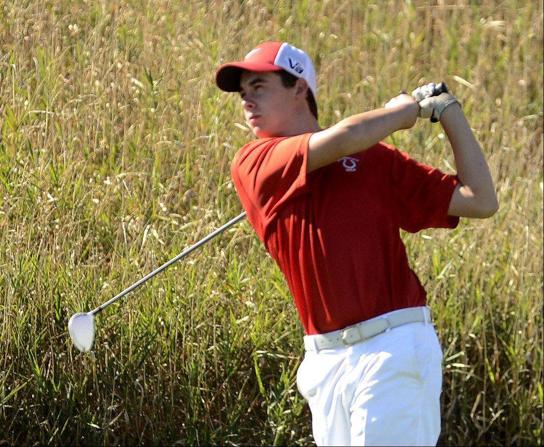 Mundelein�s Derek Parola tees off on No. 5 during the Class 3A Zion-Benton boys golf regional.