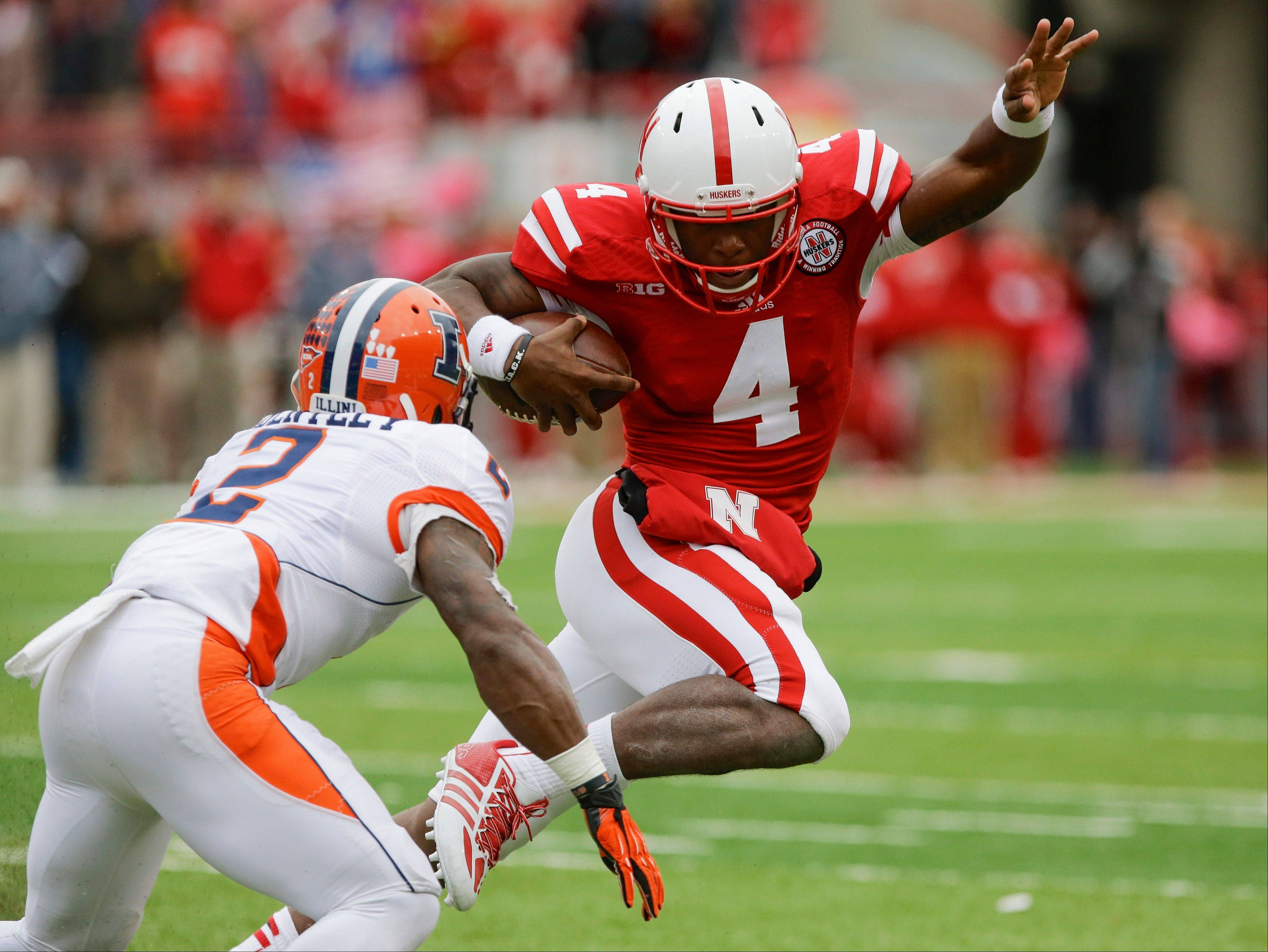 Nebraska quarterback Tommy Armstrong Jr. tries to outrun Illinois defensive back V�Angelo Bentley in the second half of Saturday�s game in Lincoln, Neb. Tackling was an issue for the Illini in the 39-19 loss.