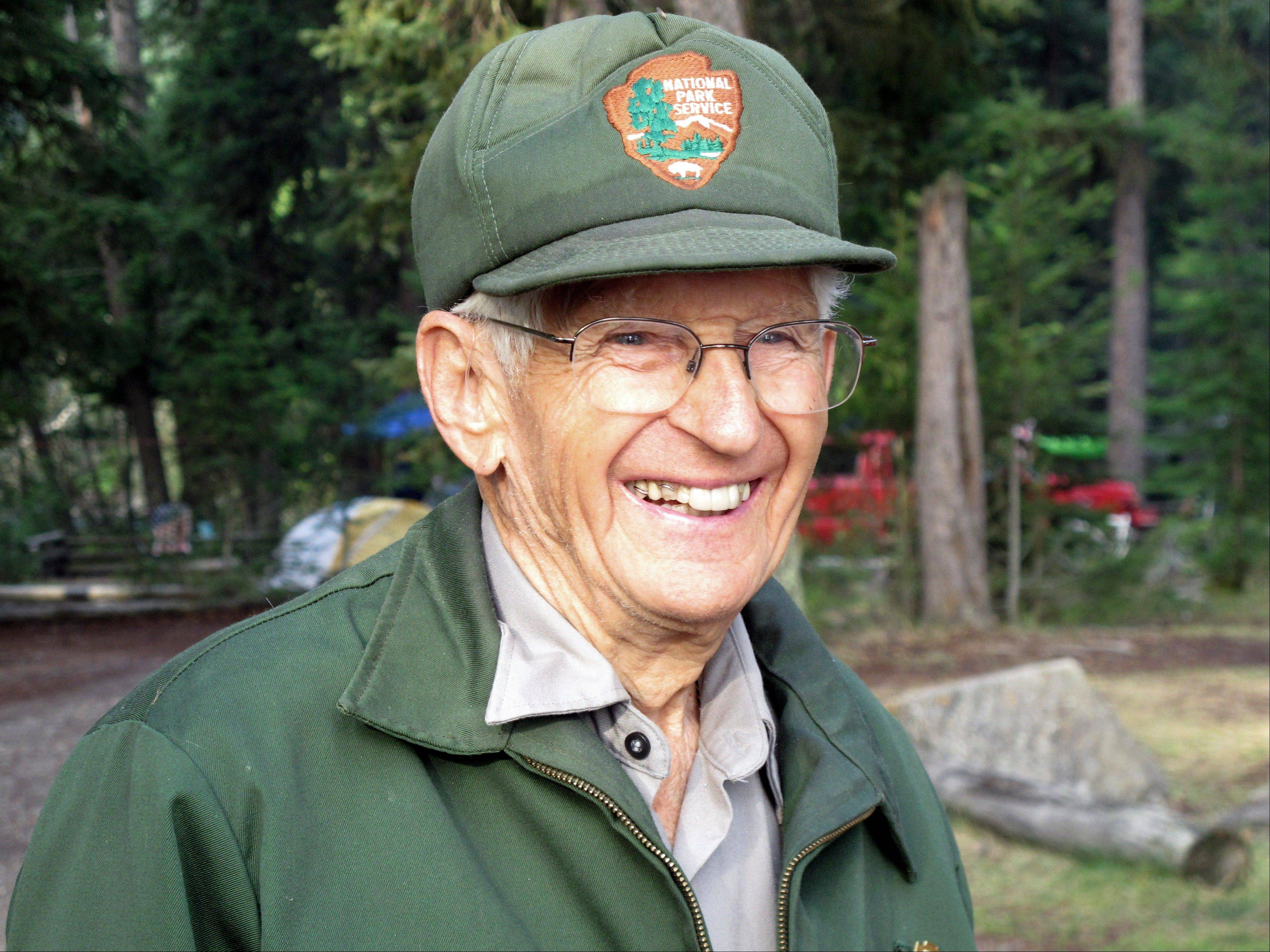 Lyle Ruterbories smiles as he speaks with a visitor to the Kintla Lake Campground in Glacier National Park, Mont. Ruterbories is the National Park Service's oldest ranger at age 93.