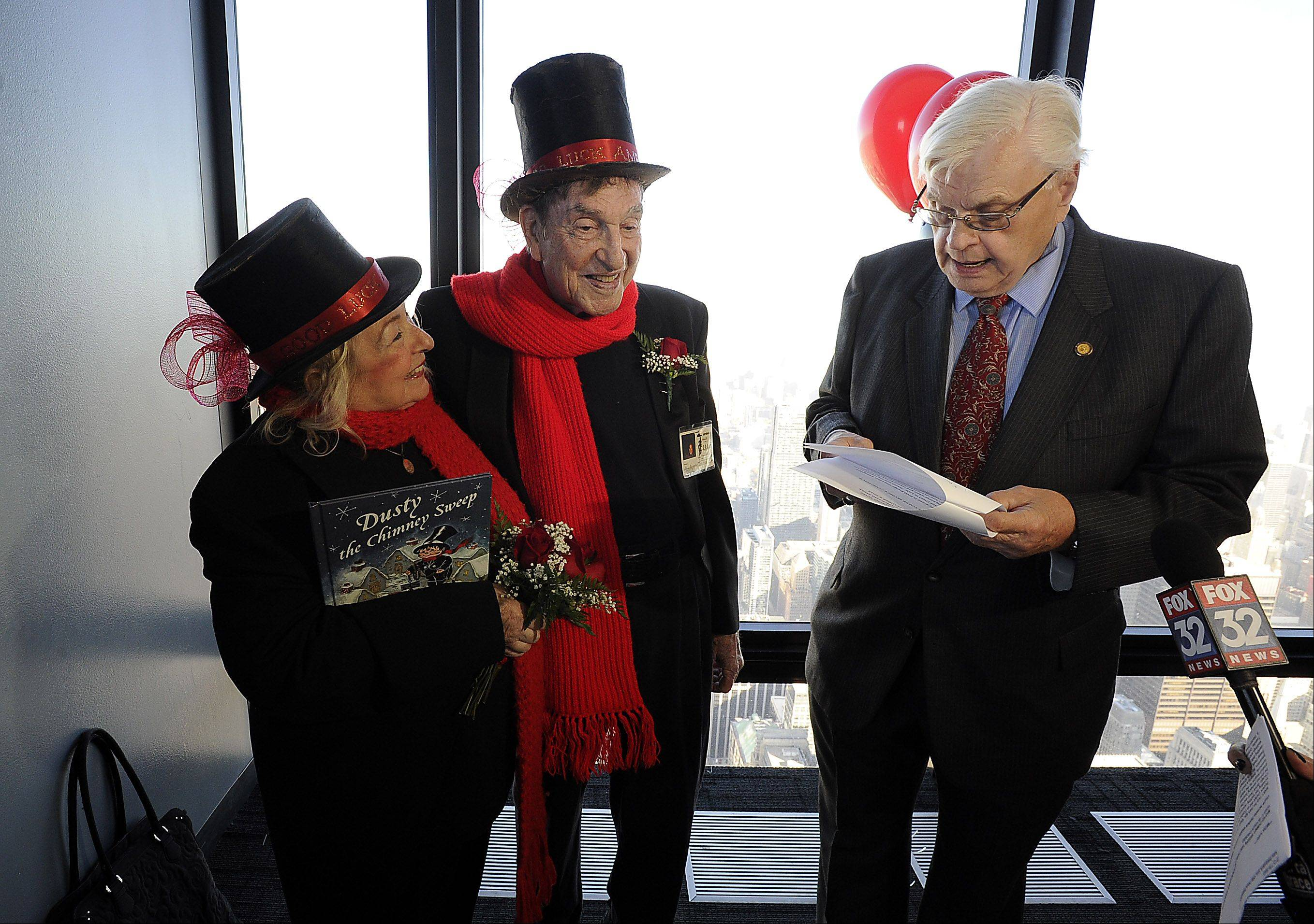 Longtime friend Fred Bunge of Batavia, right, helps David and Dee Stoll renew their wedding vows 35 years after the chimney sweeps from Roselle were married atop Chicago's tallest building.