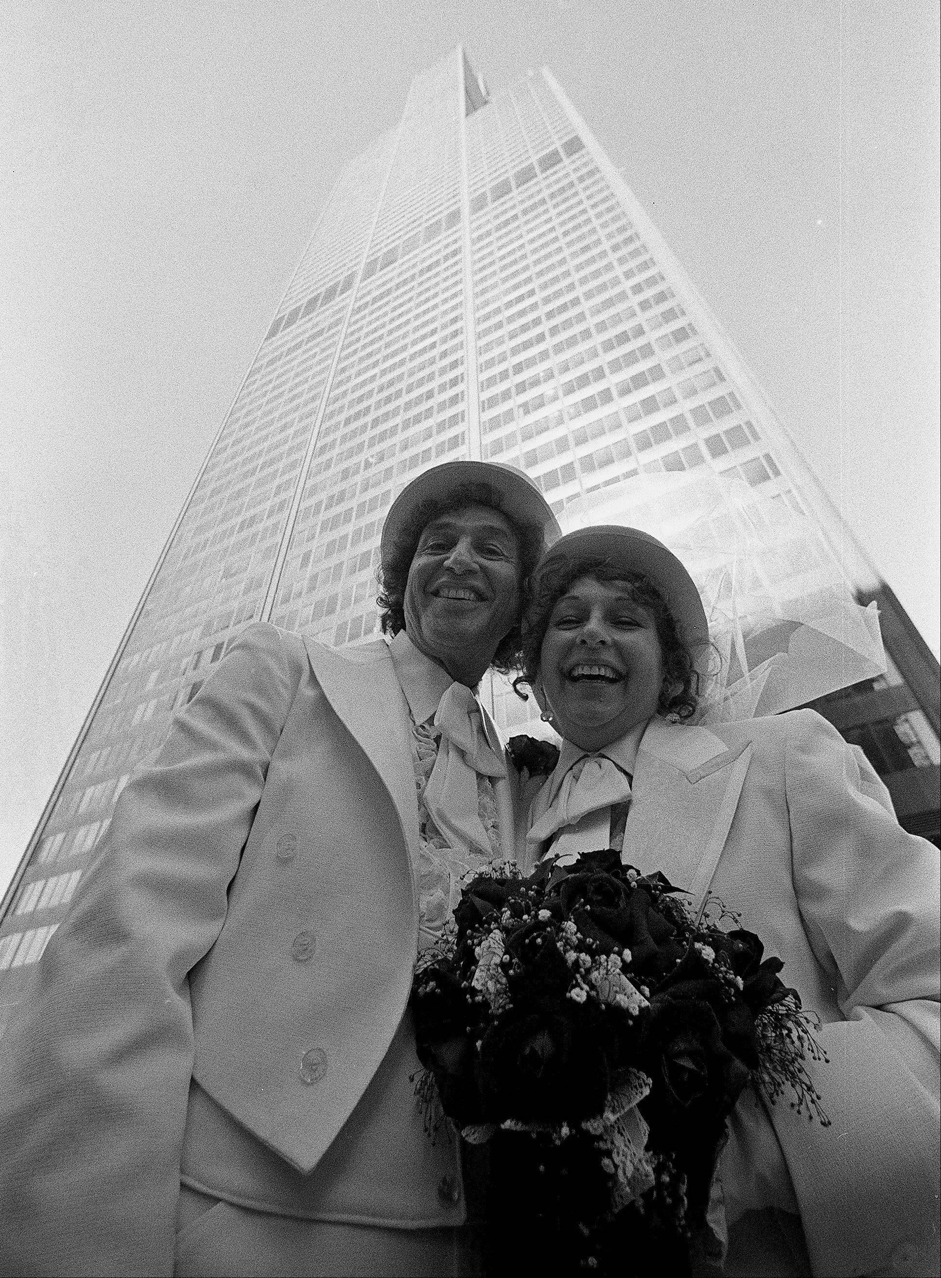 Wearing white for their 1978 wedding on top of the Sears Tower, David and Dee Stoll of Roselle don black tuxes and top hats as they renew their vows from the Skydeck of the Willis Tower.