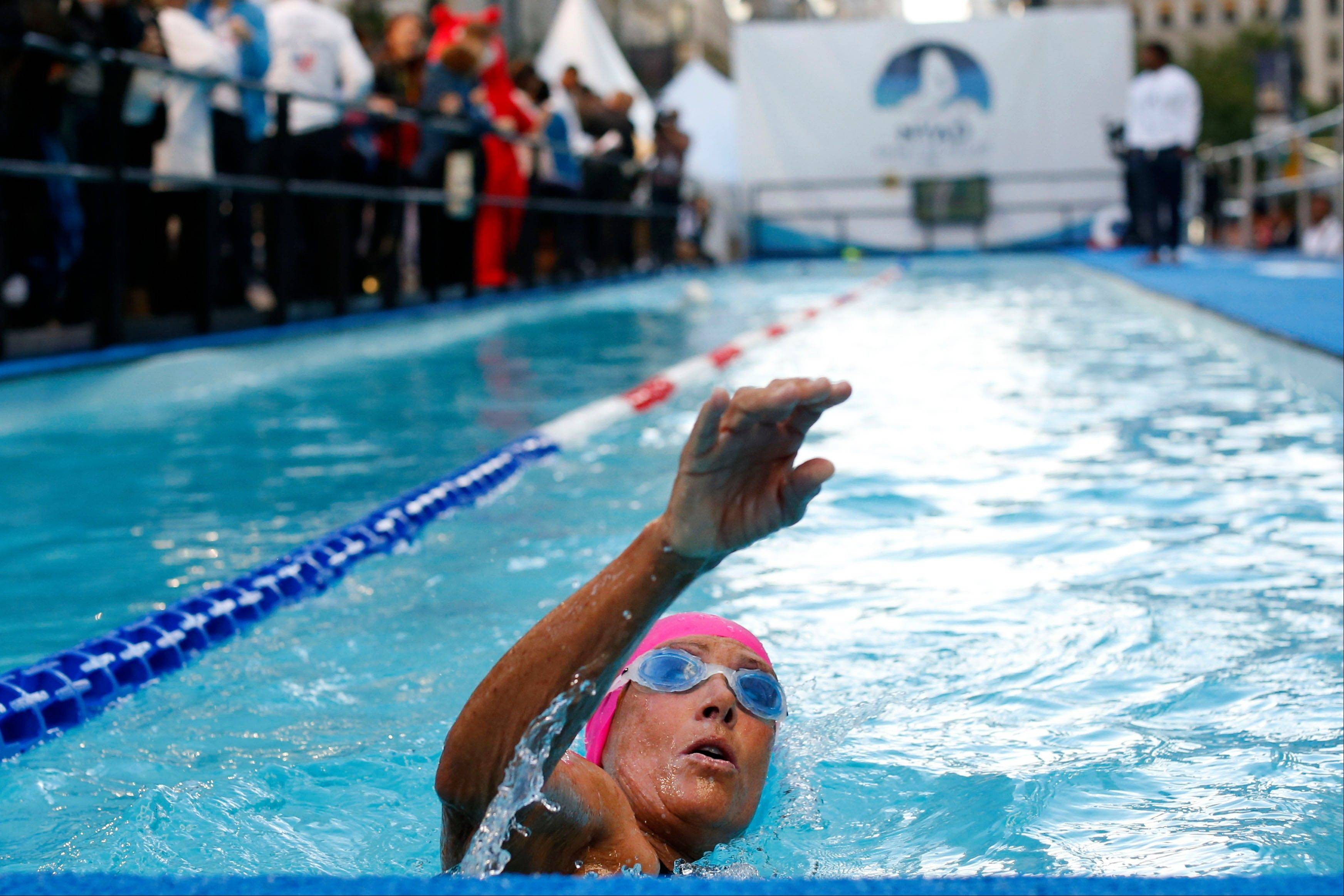 "Long-distance swimmer Diana Nyad, who recently completed a record-breaking swim from Cuba to Florida, completes a lap during a continuous 48-hour swim event in New York's Herald Square called ""Swim for Relief,"" which aims to raise funds and awareness for Hurricane Sandy recovery efforts, Tuesday, Oct. 8, 2013."