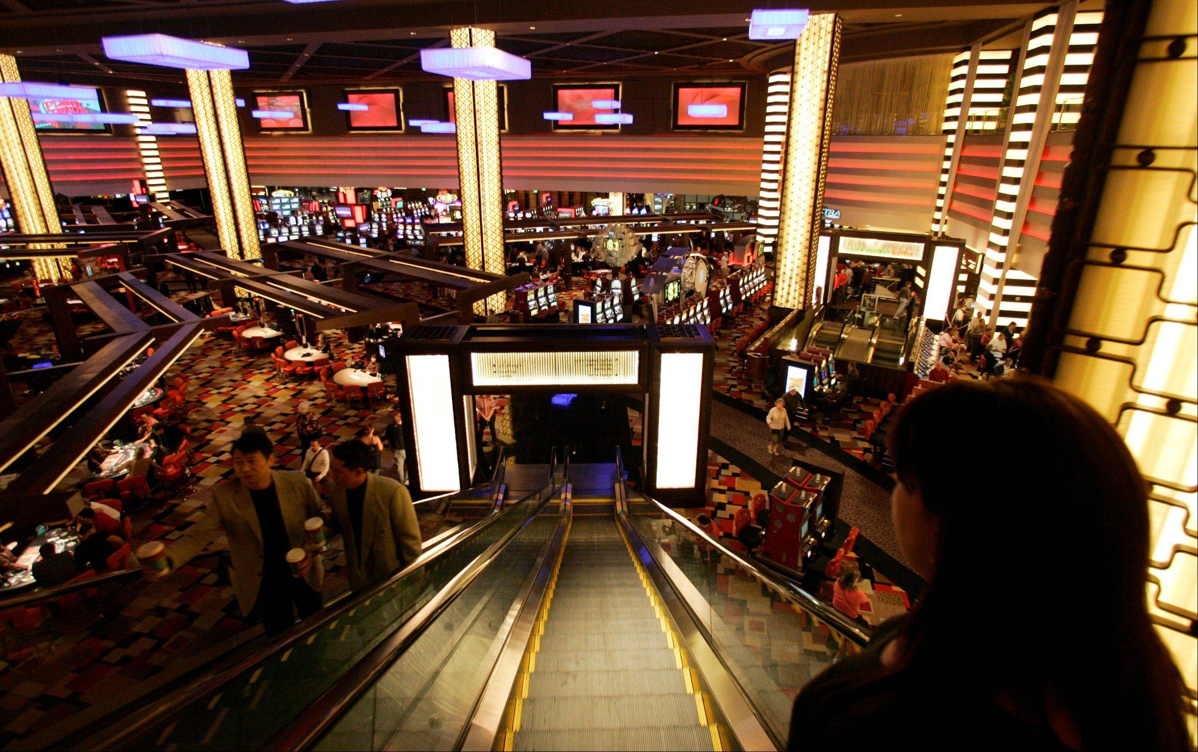 Guests descend an escalator to the main casino floor of the Planet Hollywood Resort & Casino in Las Vegas. While casinos have thousands of cameras watching the gaming floors, entrances and some elevators, cameras are absent in the hallways of the guest room floors where thousands of crimes occur.