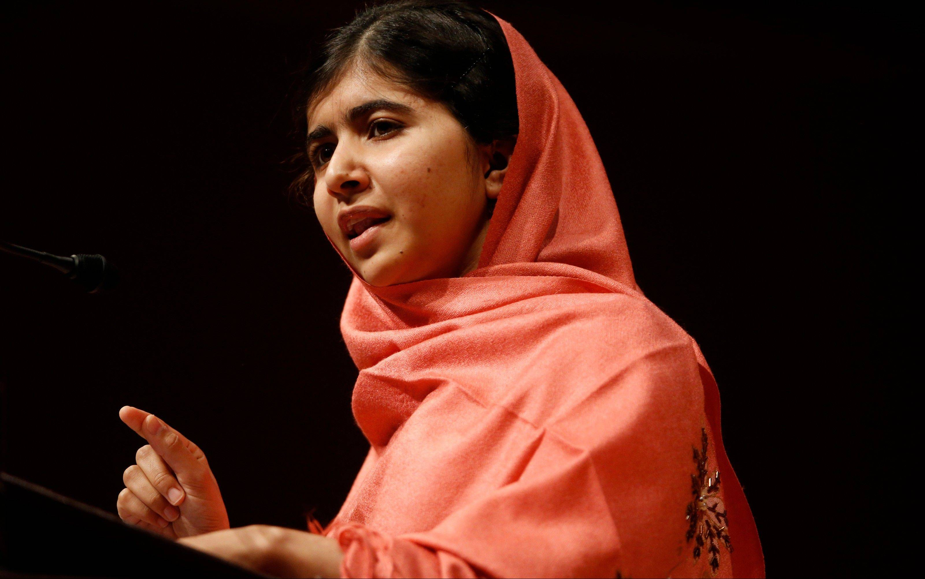 "Malala Yousafzai addresses students and faculty after receiving the 2013 Peter J. Gomes Humanitarian Award at Harvard University, on the school's campus in Cambridge, Mass. A year ago, Malala Yousafzai was a schoolgirl in northwest Pakistan, thinking about calculus and chemistry, Justin Bieber songs and ""Twilight"" movies. Today she's the world-famous survivor of a Taliban assassination attempt, an activist for girls' education -- and a contender to win the Nobel Peace Prize on Friday Oct. 11, 2013."