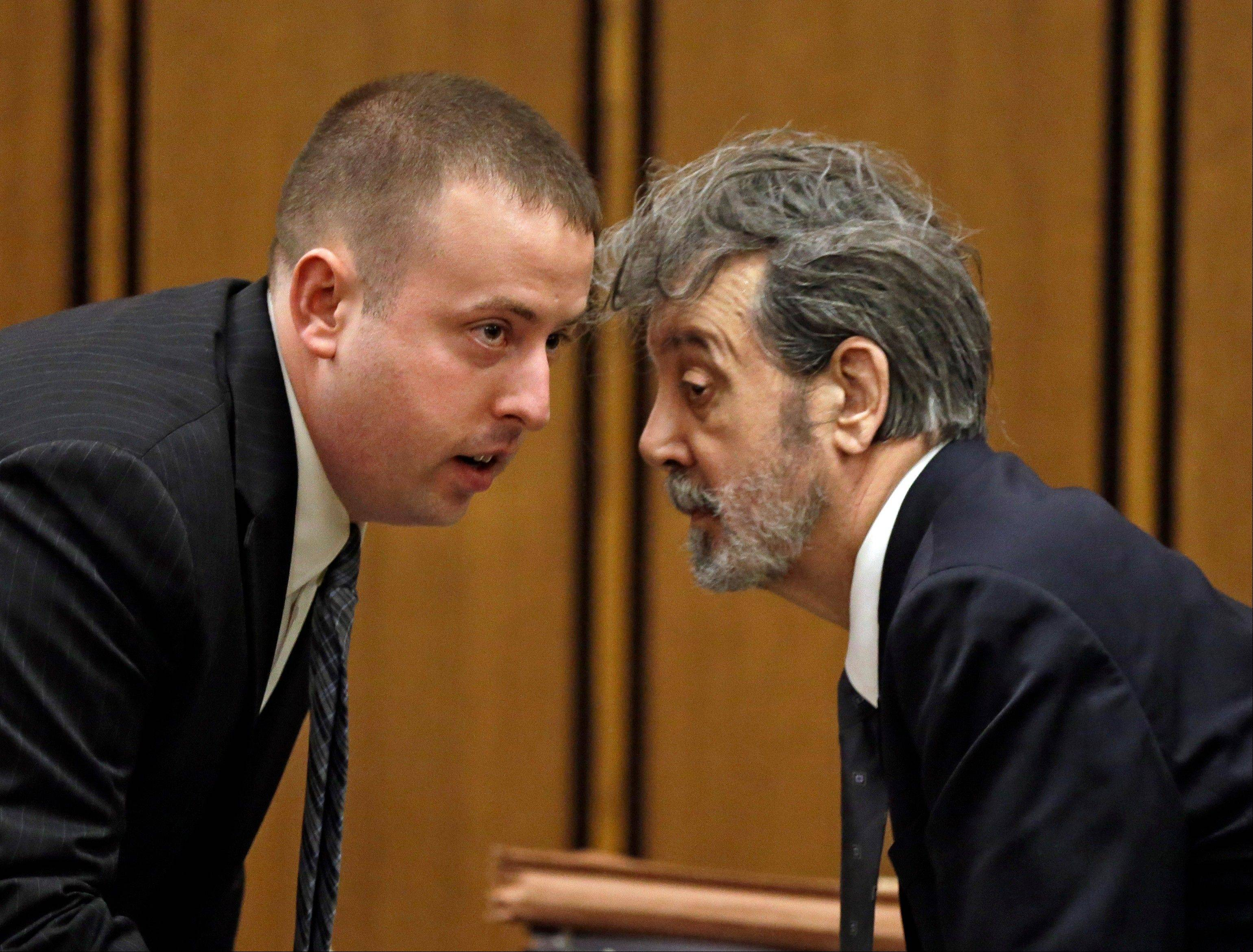 The man who calls himself Bobby Thompson, right, talks with defense attorney Joseph Patituce during opening arguments in court in Cleveland Monday, Oct. 7, 2013. Thompson, 67, who authorities have identified as John Donald Cody, is charged with masterminding a $100 million multistate fraud under the guise of helping Navy veterans.