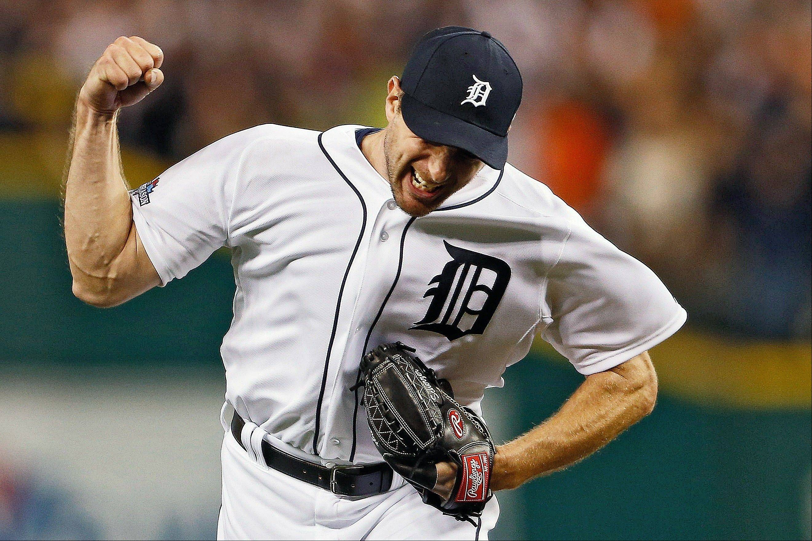 Tigers pitcher Max Scherzer celebrates after Oakland's Alberto Callaspo lined out to center for the last out of the eighth inning Tuesday in Game 4 of baseball's American League Division Series in Detroit.
