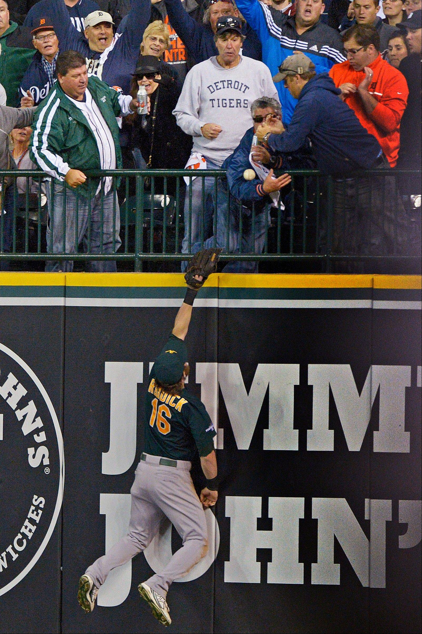 Oakland Athletics right fielder Josh Reddick stretches but is unable to catch a home run by the Tigers' Victor Martinez during the seventh inning Tuesday n Detroit. The Tigers won 8-6.