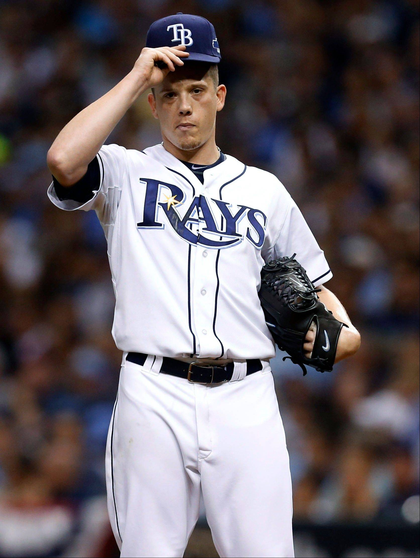 Rays starting pitcher Jeremy Hellickson waits as manager Joe Maddon approaches the mound in the second inning in Game 4. Hellickson was replaced by pitcher Jamey Wright.