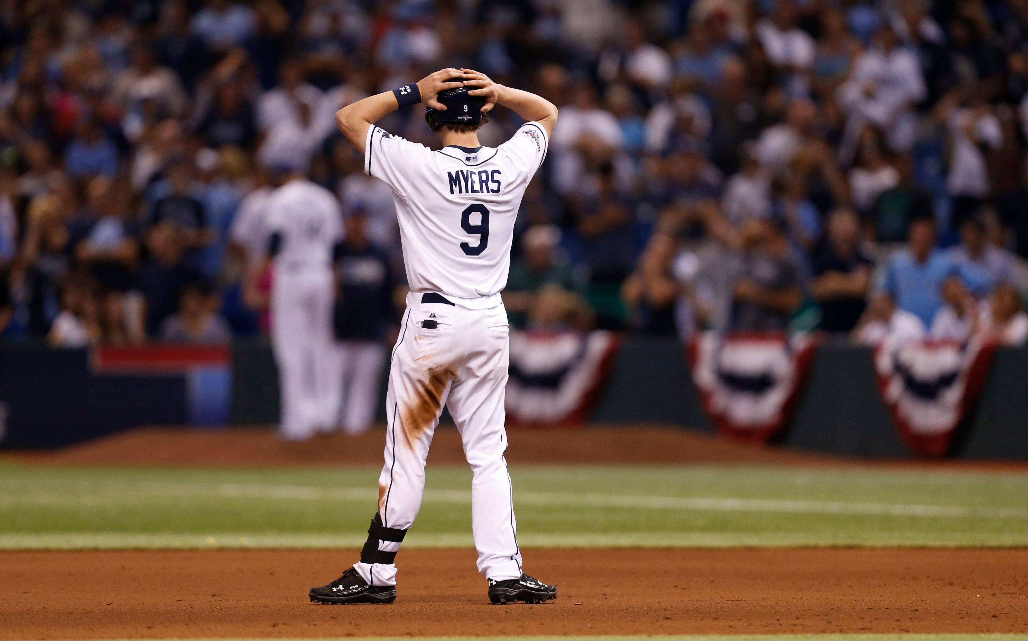 Tampa Bay right fielder Wil Myers stands on the field in the ninth inning in Game 4. The Rays' season ended Tuesday night.