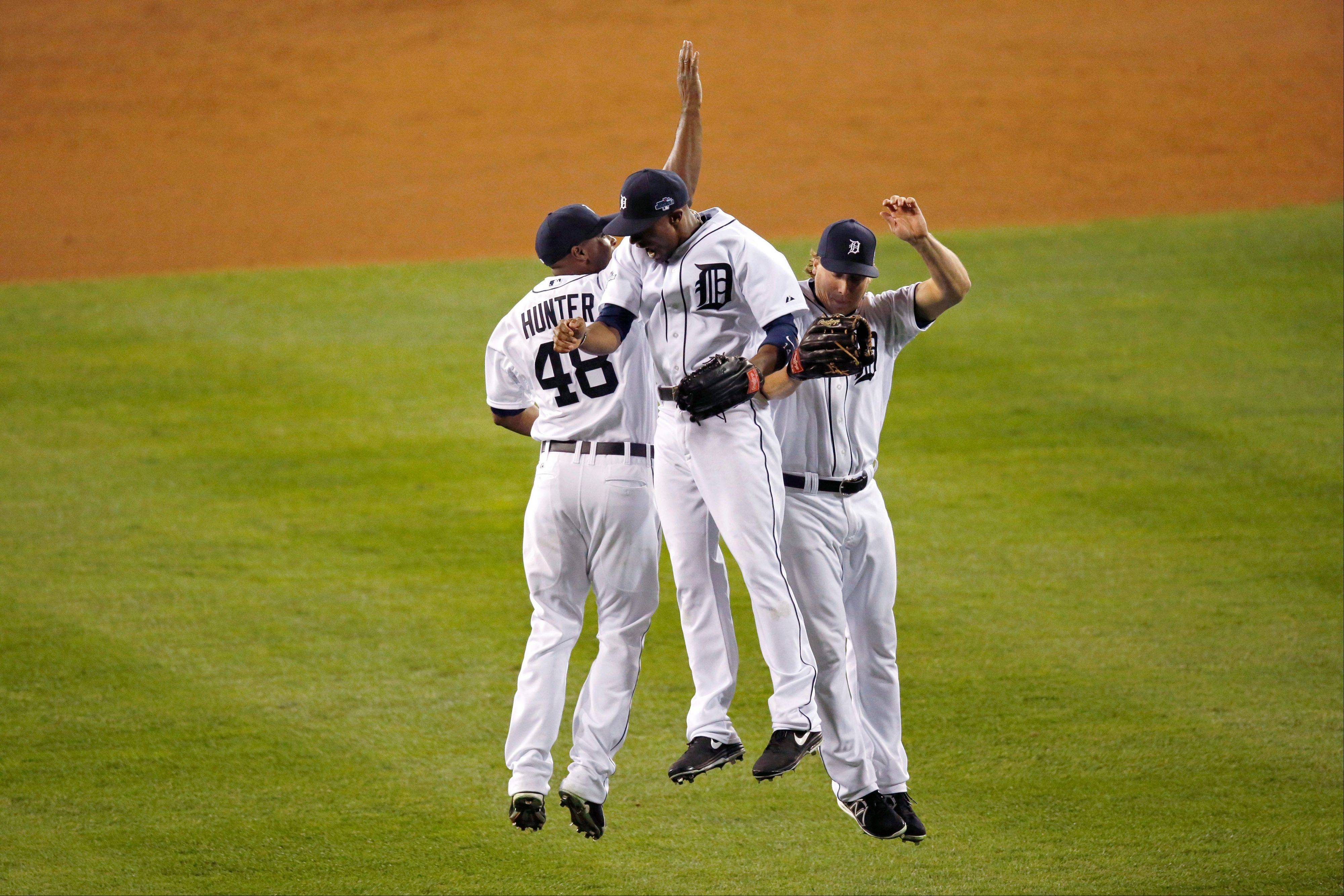 Tigers right fielder Torii Hunter, center fielder Austin Jackson, center, and left fielder Andy Dirks celebrate the Tigers' 8-6 win over the Oakland Athletics in Game 4 of an American League Division Series in Detroit.