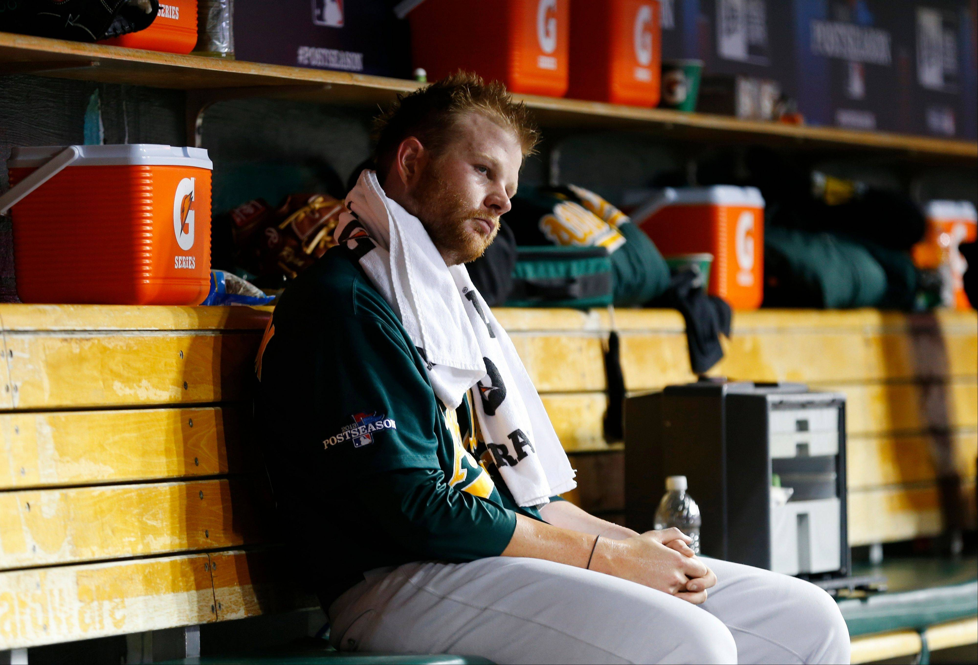 Oakland Athletics relief pitcher Brett Anderson sits in the dugout during the ninth inning of Tuesday's game.