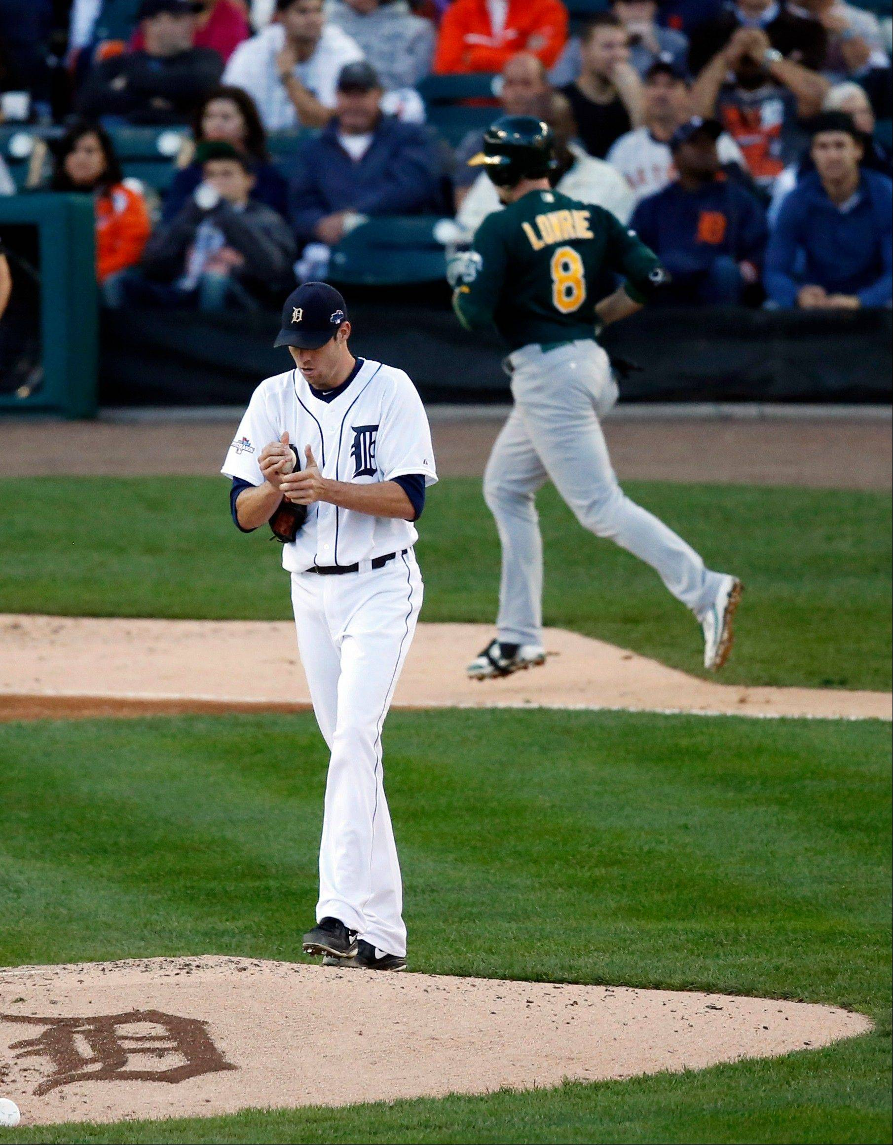 Tigers starting pitcher Doug Fister walks back to the mound as Athletics shortstop Jed Lowrie rounds the bases on a two-run homer during the fifth inning Tuesday night in Detroit.
