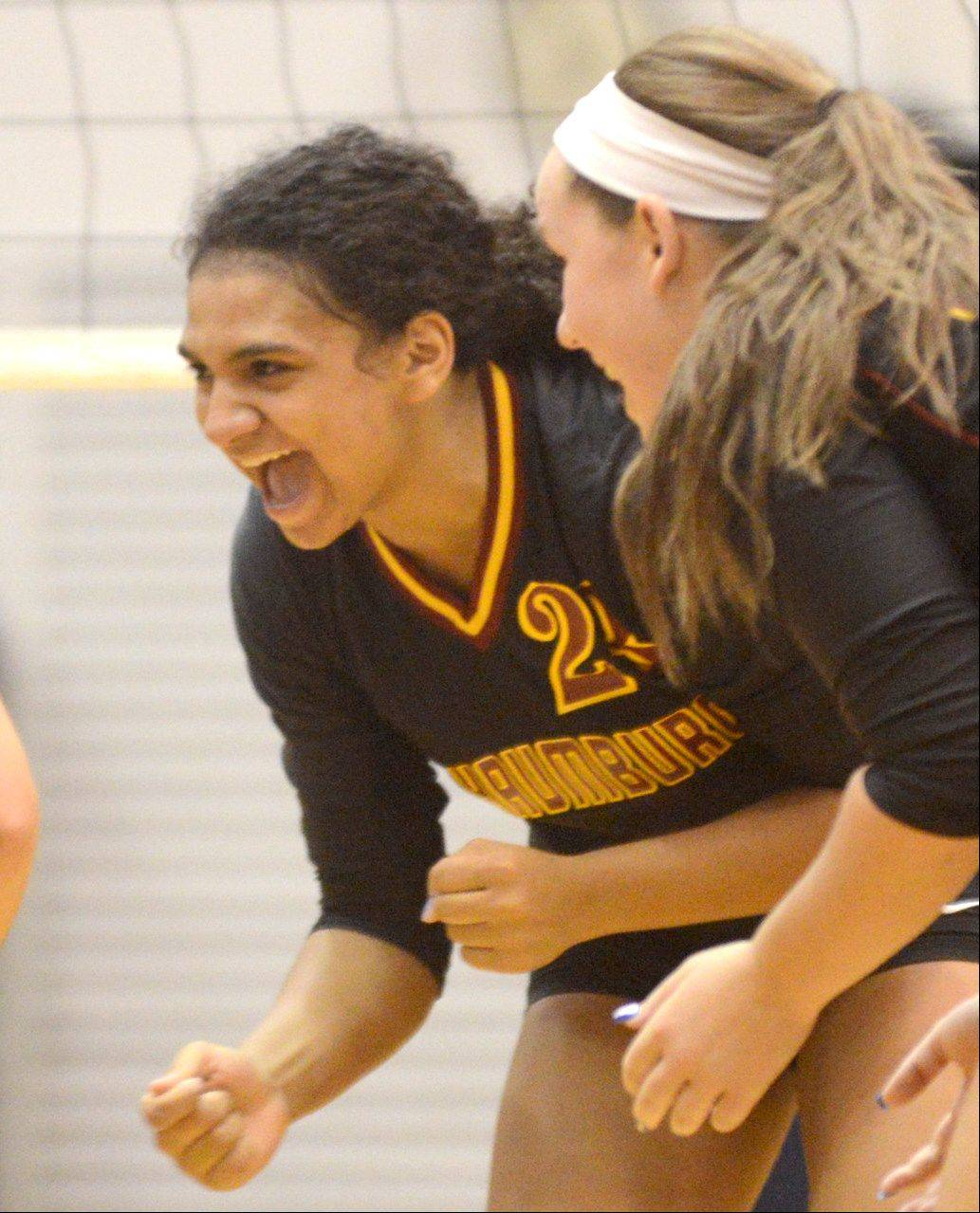Schaumburg's Lexi Ross celebrates a point during varsity volleyball at Conant on Tuesday night.