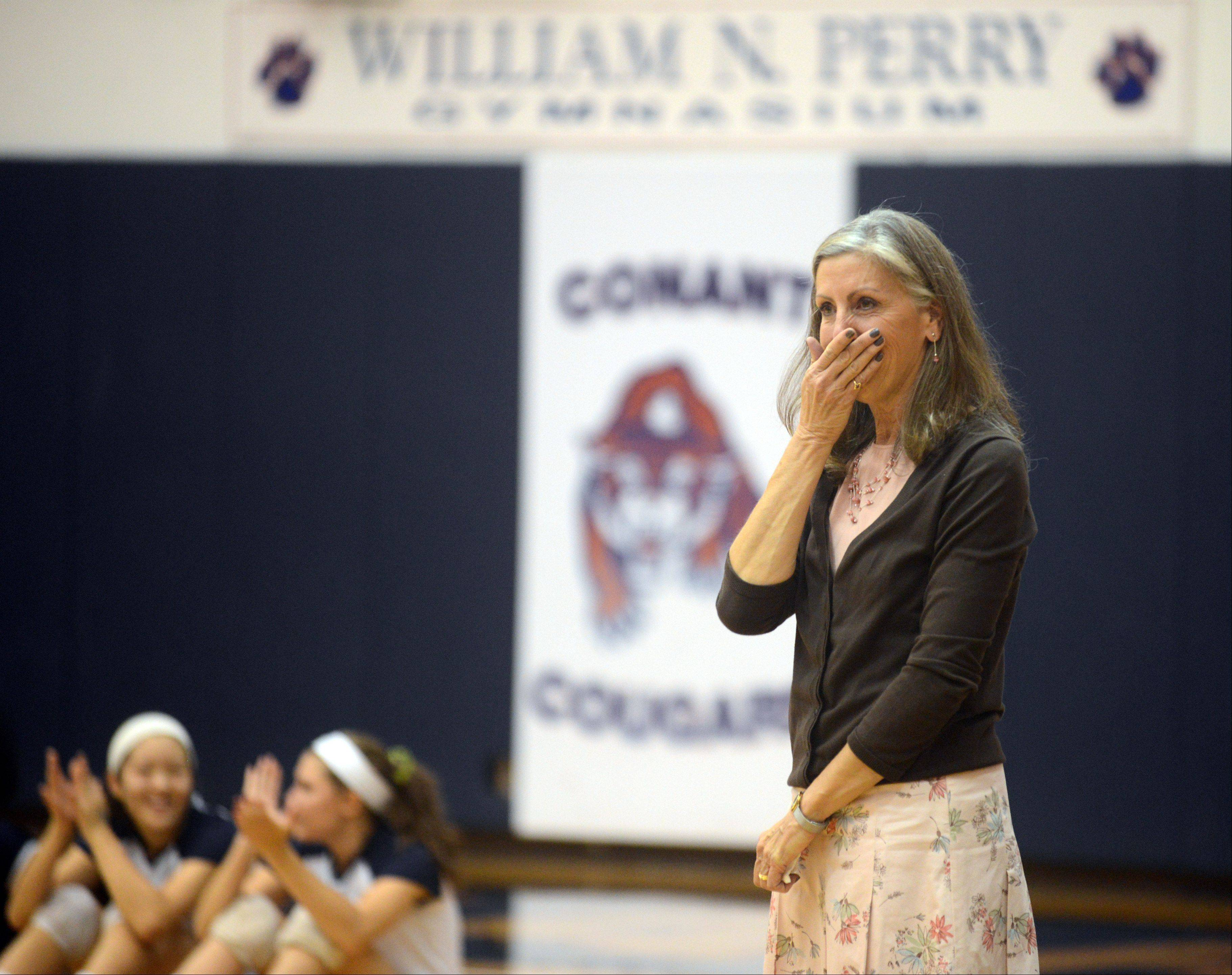 Conant volleyball coach Peggy Scholten was honored before a game with Schaumburg on Tuesday night at William N. Perry Gymnasium. Scholten is retiring after this, her 37th year of coaching. Here, Scholten reacts after learning that an annual early season tournament will now bear her name.