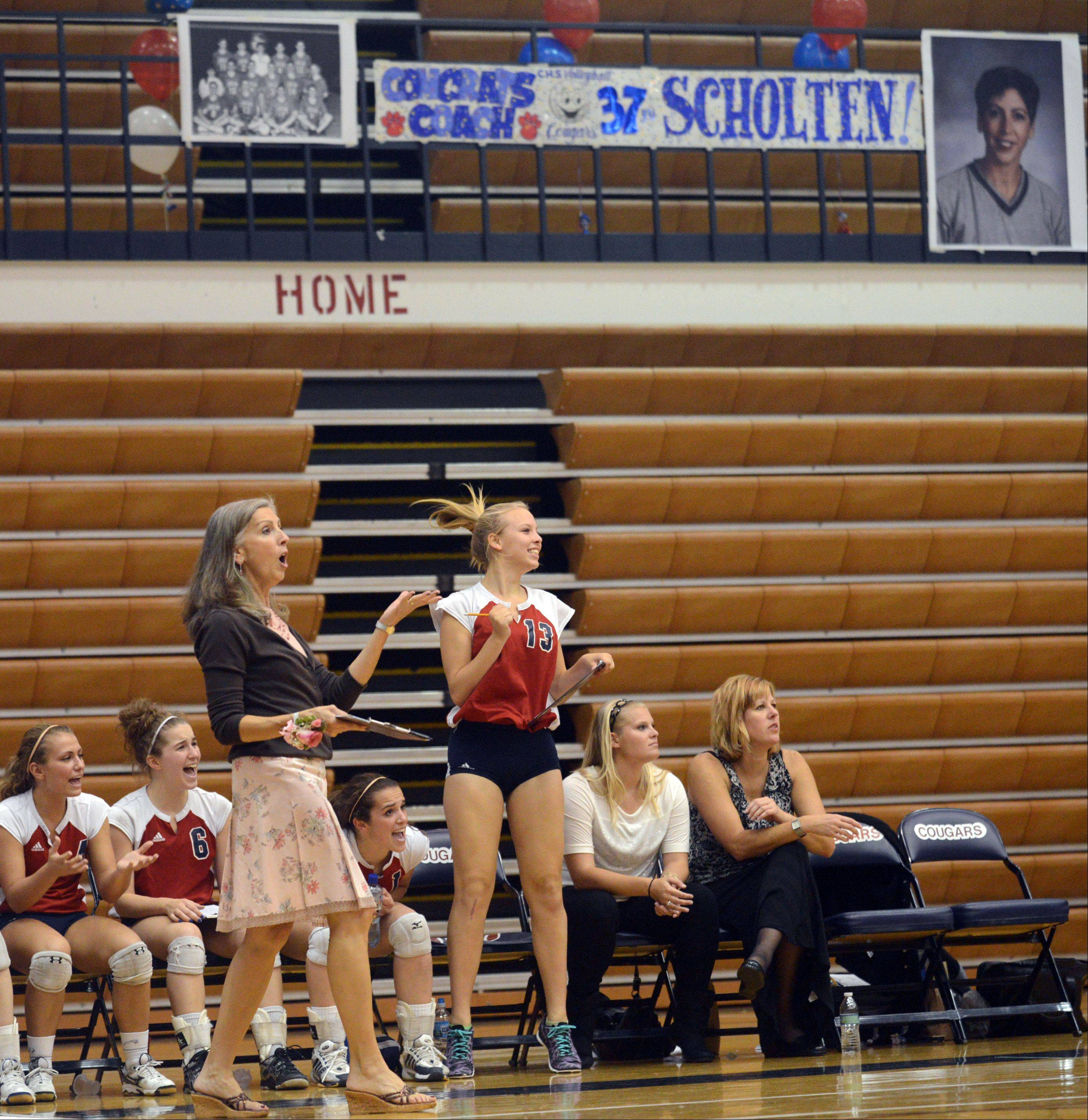 Patrick Kunzer/pkunzer@dailyherald.comConant volleyball coach Peggy Scholten was honored before a game with Schaumburg on Tuesday night at William N. Perry Gymnasium. Scholten is retiring after this, her 37th year of coaching. Here, she celebrates a point with player Katie Lomas.
