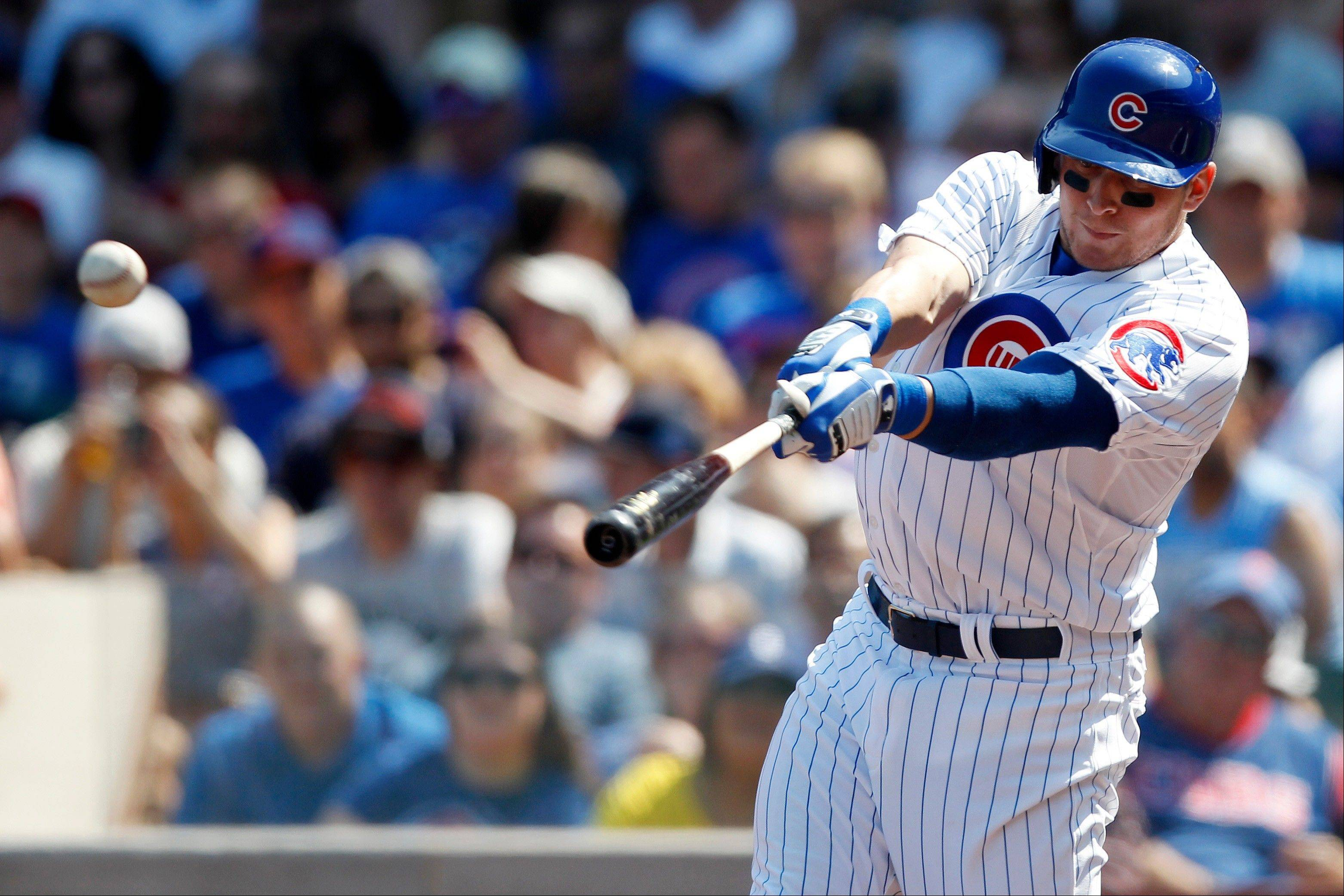 Chicago Cubs' Ryan Sweeney hits a single against the Philadelphia Phillies during the first inning of a baseball game on Sunday, Sept. 1, 2013, in Chicago.