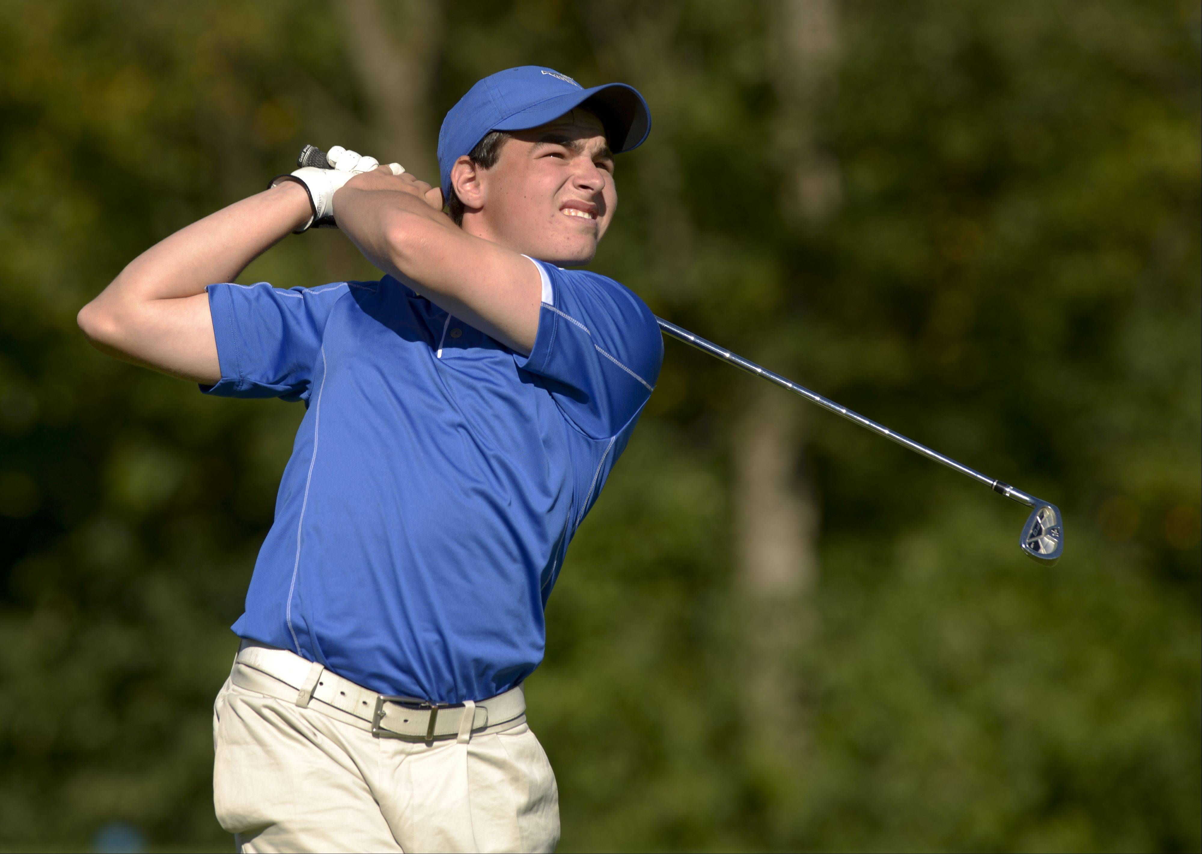 Matt Winkelmar of Wheaton North tees off on three during the Class 3A York regional boys golf at Maple Meadows Golf Course in Wood Dale, Tuesday.