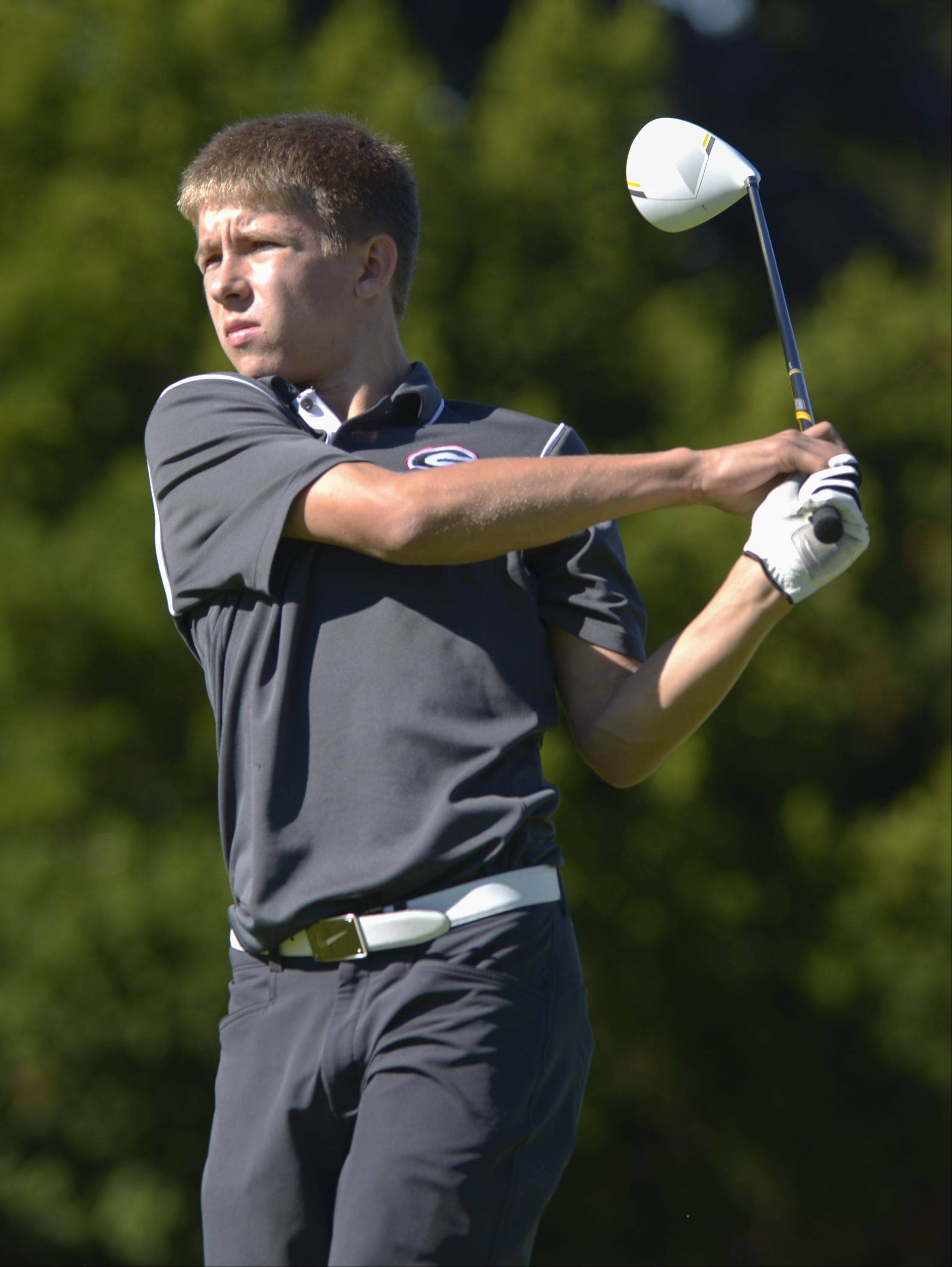 Ben Symonds of Glenbard East tees off during the Class 3A York regional boys golf at Maple Meadows Golf Course in Wood Dale, Tuesday.