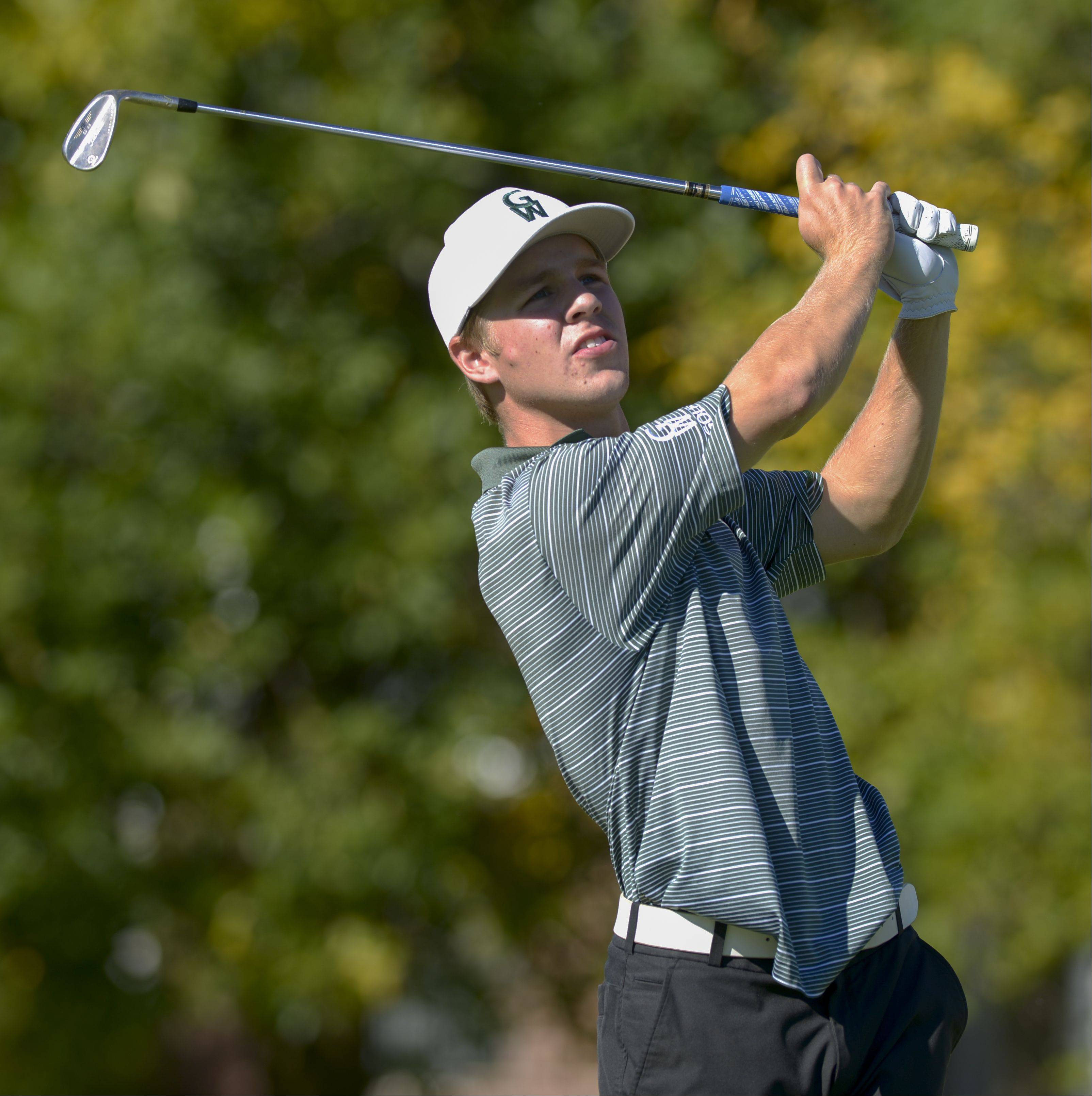Will Hanson of Glenbard West tees off during the Class 3A York regional boys golf at Maple Meadows Golf Course in Wood Dale, Tuesday.