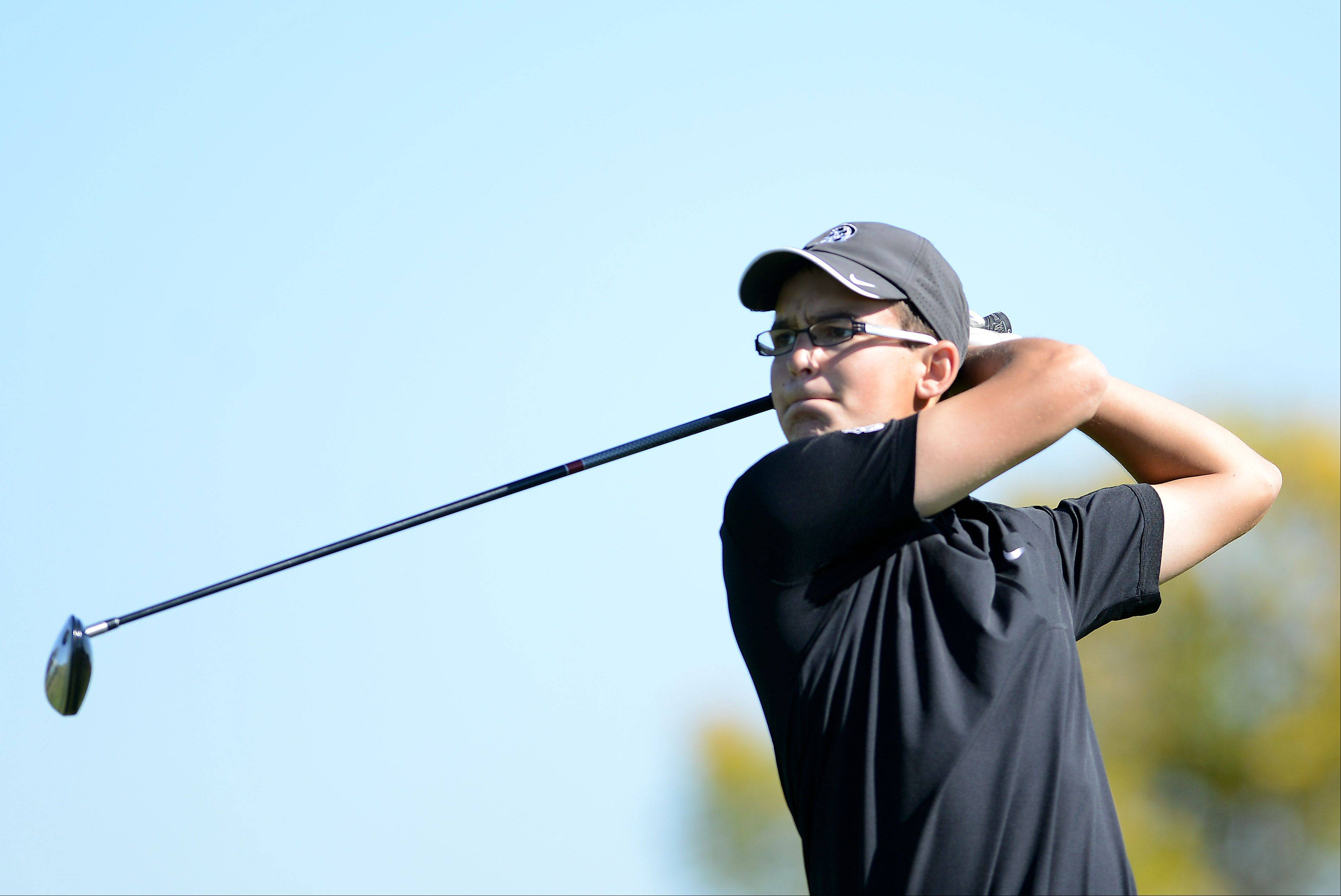 Kaneland's Brody Kuhar tees off on the sixth during Tuesday's regional golf action at Phillips Park in Aurora.