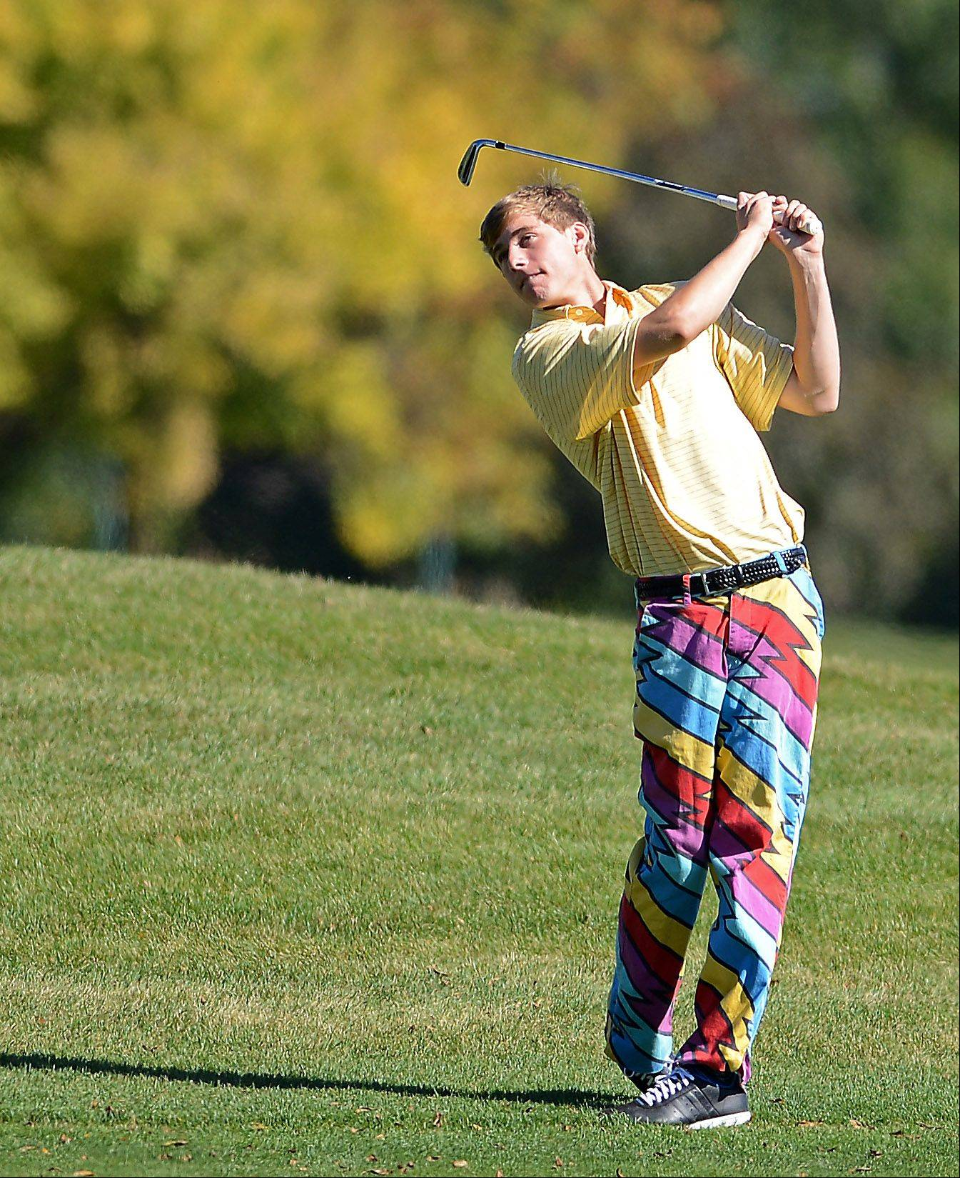 Aurora Central Catholic's Justin Prince hits from the third fairway during Tuesday's regional golf action at Phillips Park in Aurora.