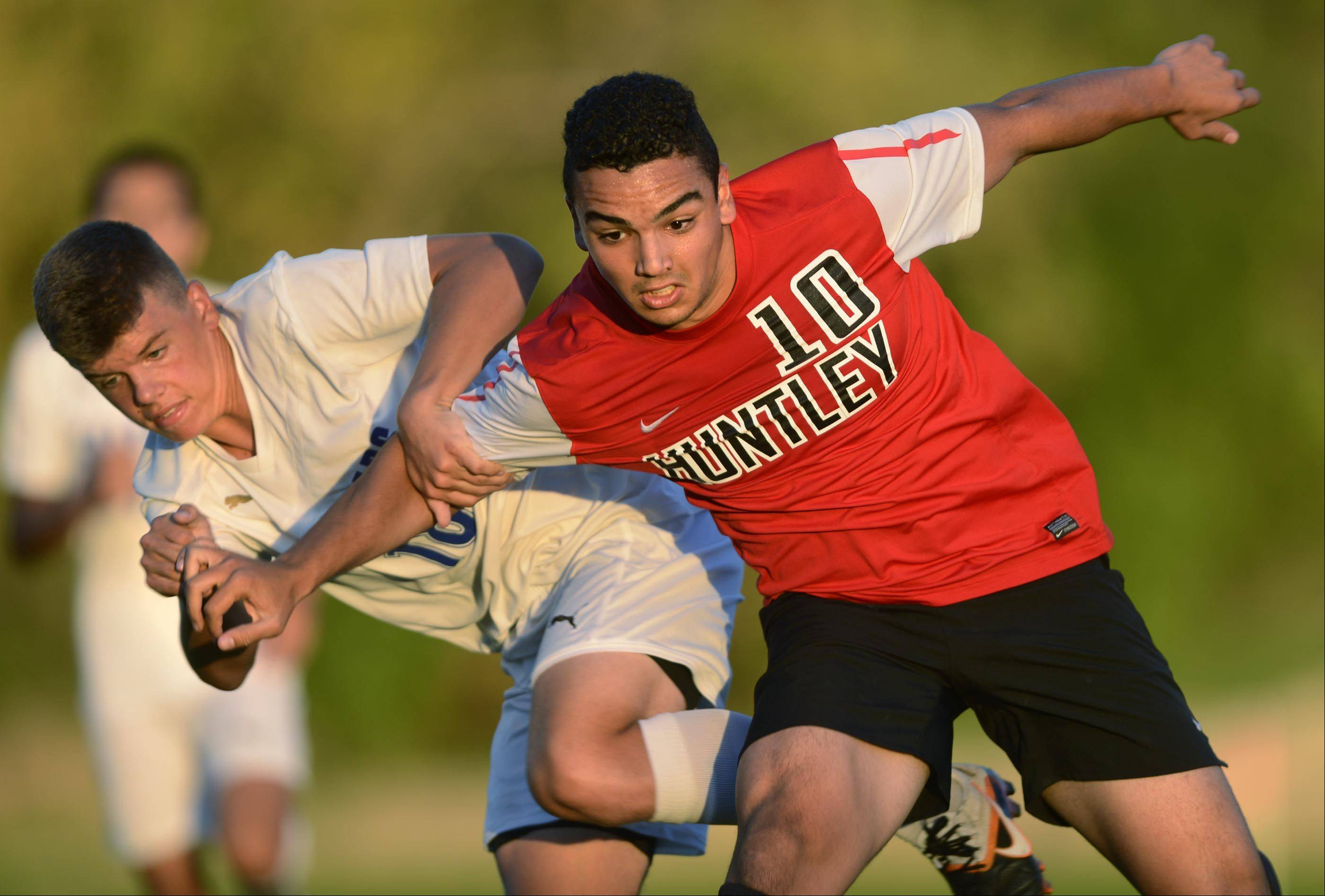 Huntley's Nikolaos Mihalopoulos and Dundee-Crown's Jason Horcher fight for the ball Tuesday in Carpentersville.