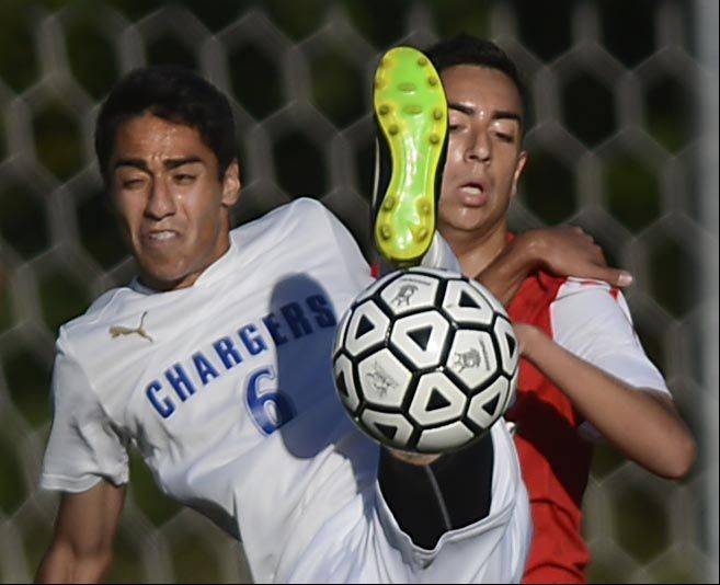 Dundee-Crown's William Campos falls back on Huntley's Eduardo Gonzalez Tuesday in Carpentersville.