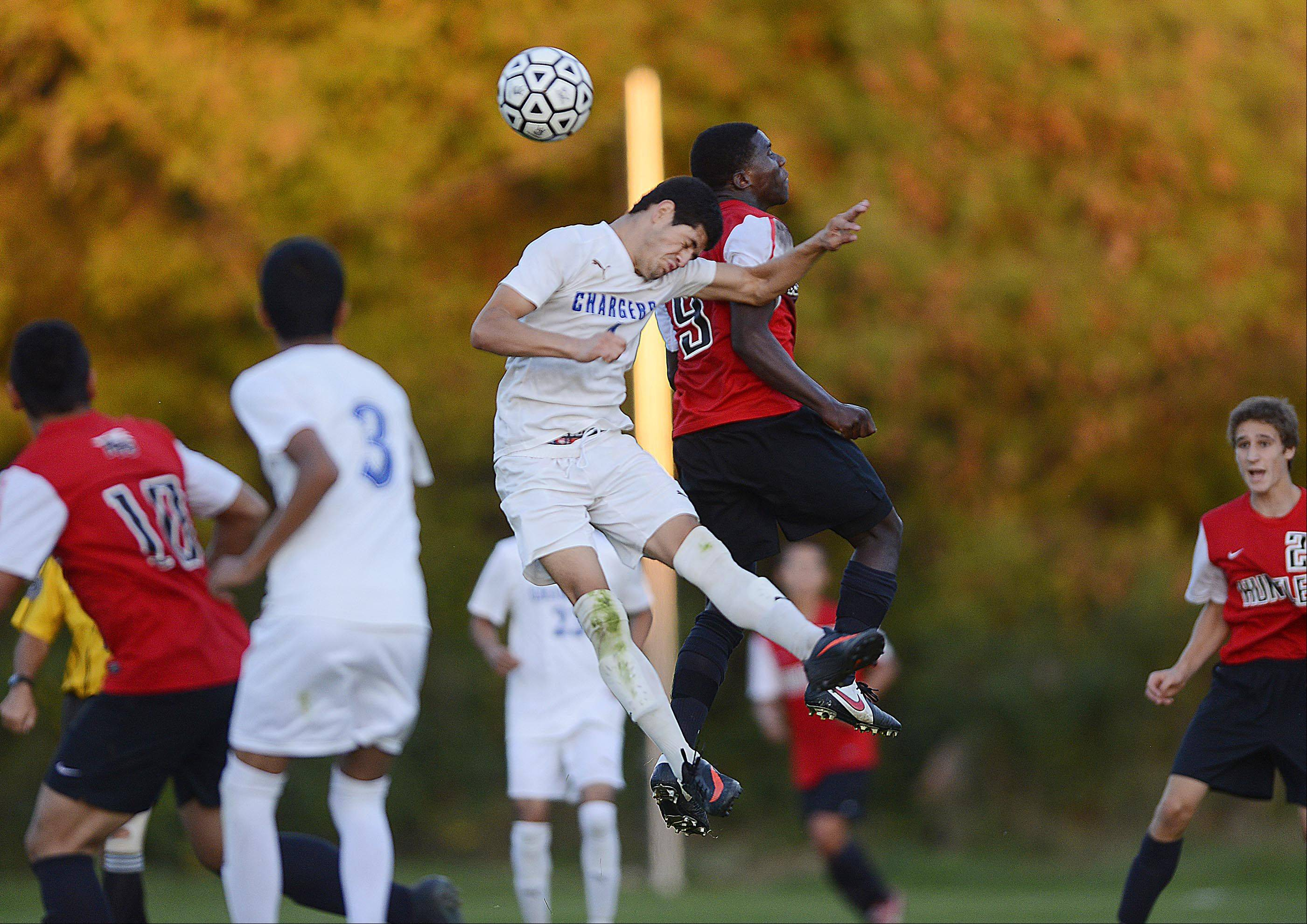 Dundee-Crown's Eduardo Arellano and Huntley's Scott Dorvilier compete for a header Tuesday in Carpentersville.