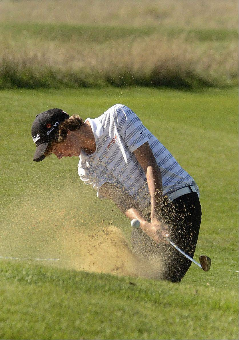 Libertyville's Billy Knutson hits out of the sand on the 11th green during the Class 3A Zion-Benton boys golf regional.