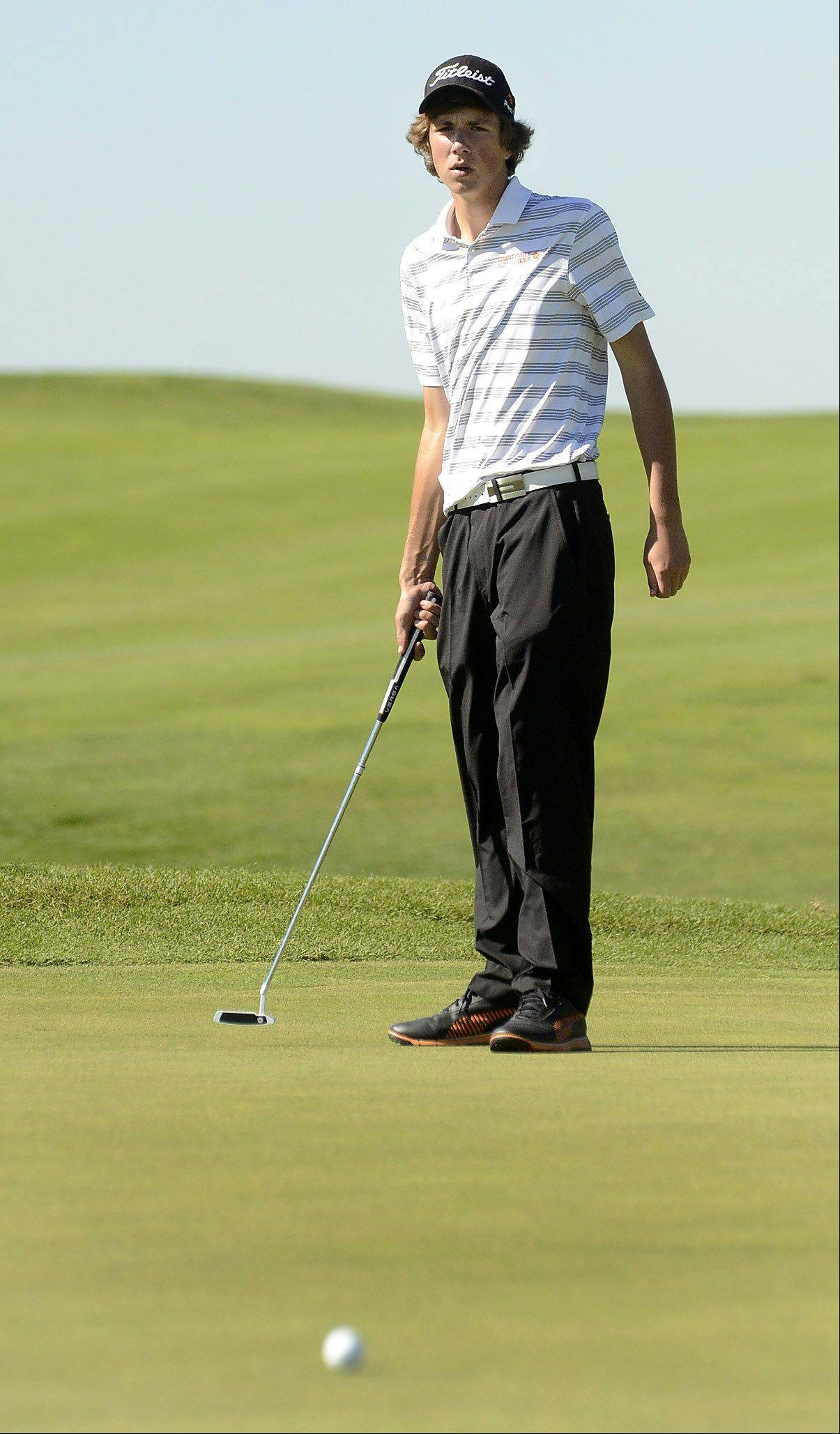 Billy Knutson of Libertyville watches his putt just miss on 13 during the Class 3A Zion-Benton boys golf regional.