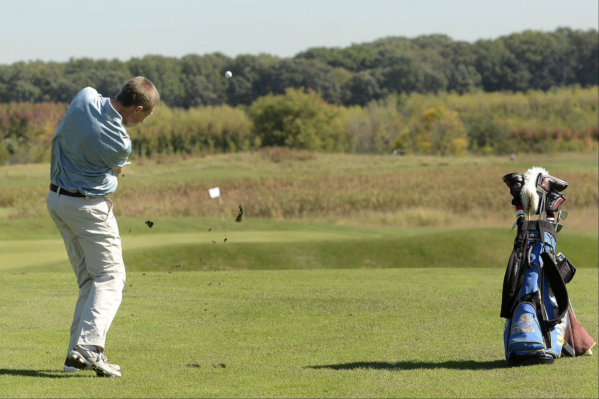 Warren's Jack Hansen tees off on No. 13 during the Class 3A Zion-Benton boys golf regional.