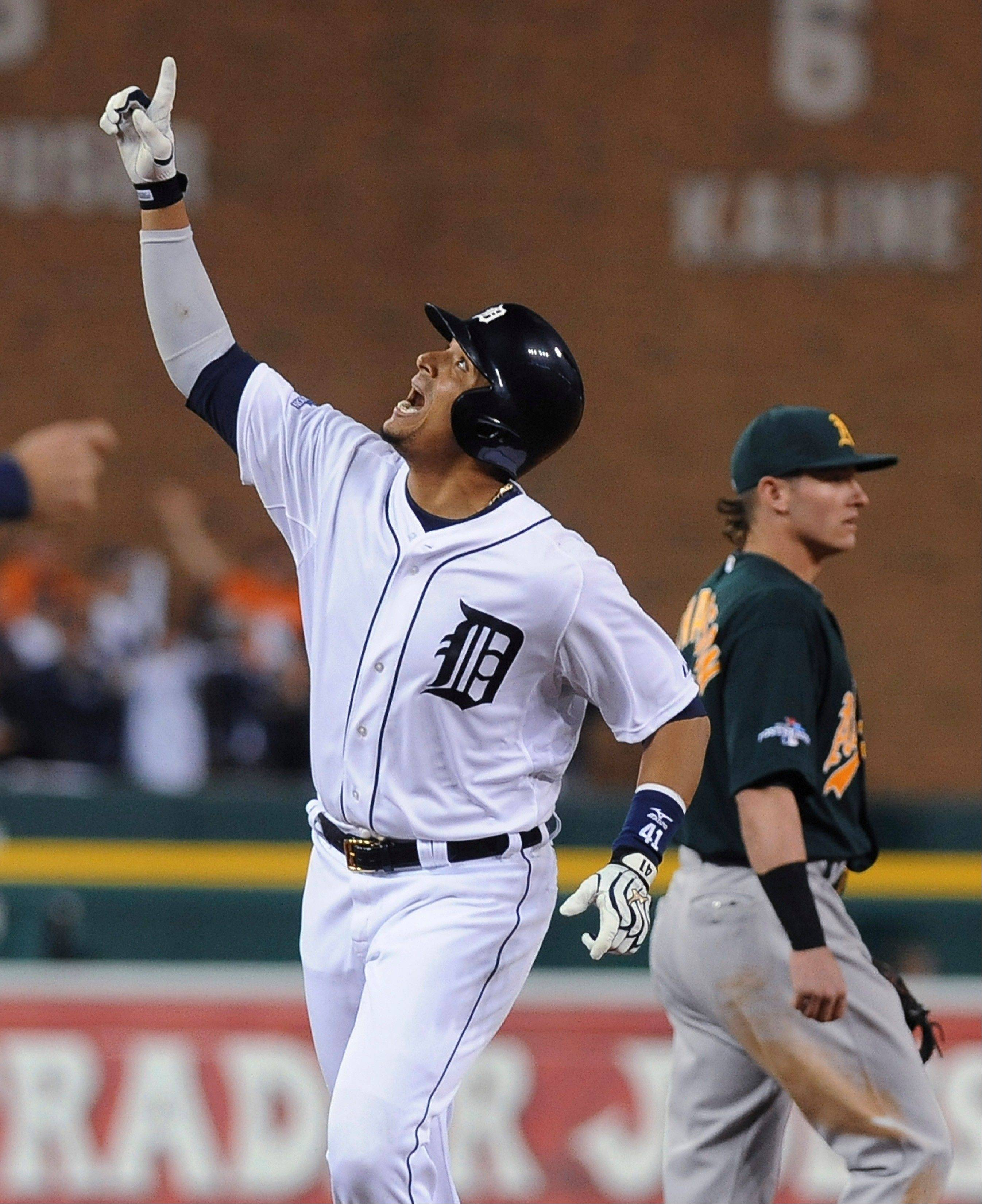 Tigers designated hitter Victor Martinez looks skyward after hitting a solo home run during the seventh inning of Game 4 Tuesday in Detroit.