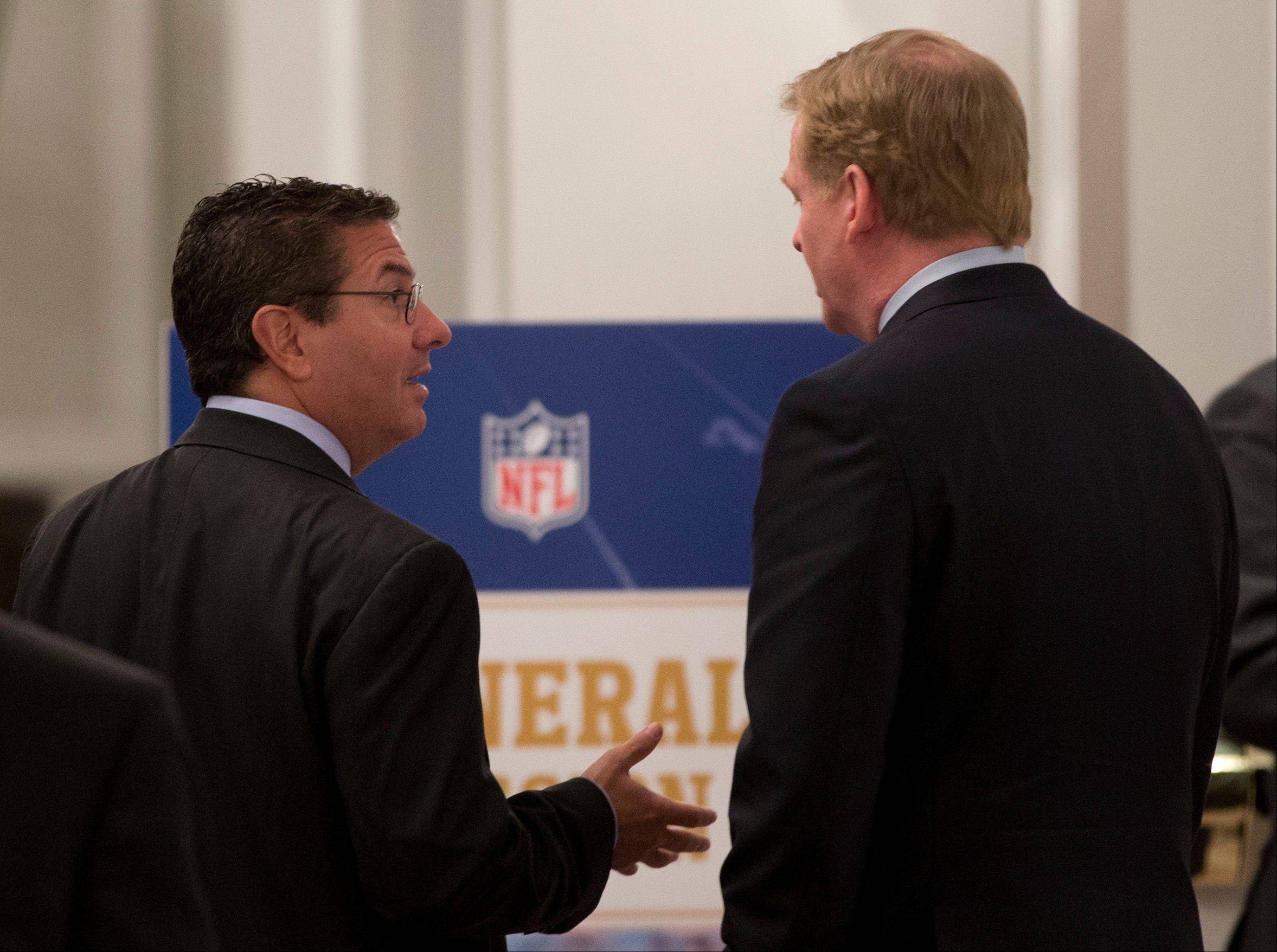 Washington Redskins football team owner Daniel Snyder, left, and NFL Commissioner Roger Goodell, talk Tuesday during a break in the NFL fall meeting in Washington.