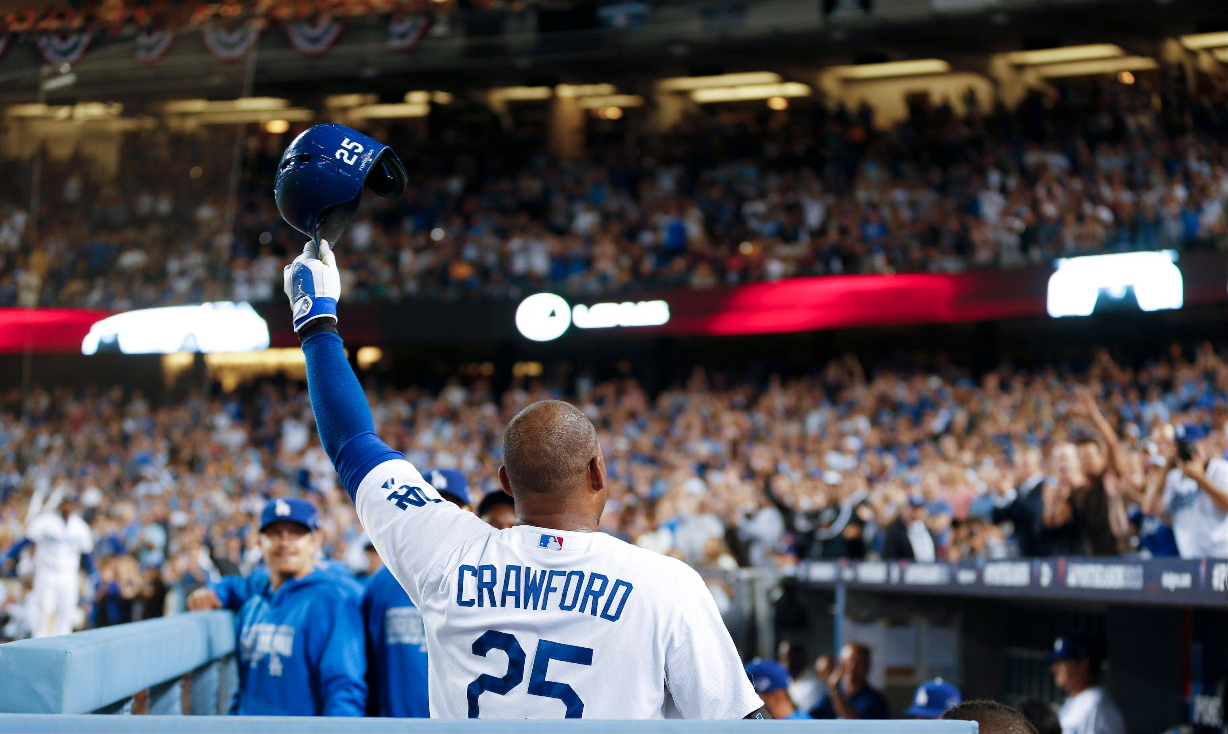 Carl Crawford tips his cap to cheering Dodgers fans after he hit a solo home run in the third inning of Game 4.