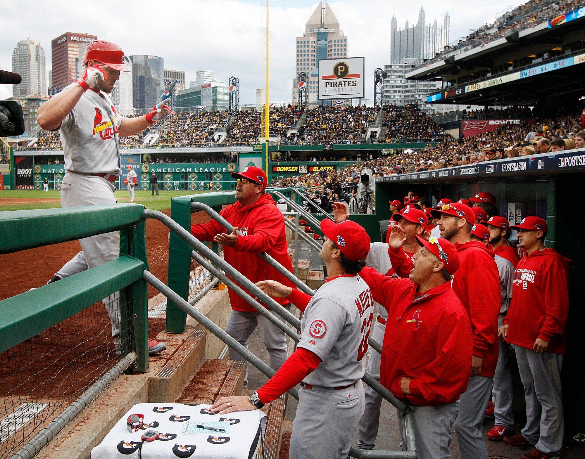 The Cardinals' Matt Holliday returns to the dugout Monday after hitting a two-run home run in the sixth inning against the Pittsburgh Pirates during Game 4 of the National League Division Series in Pittsburgh.