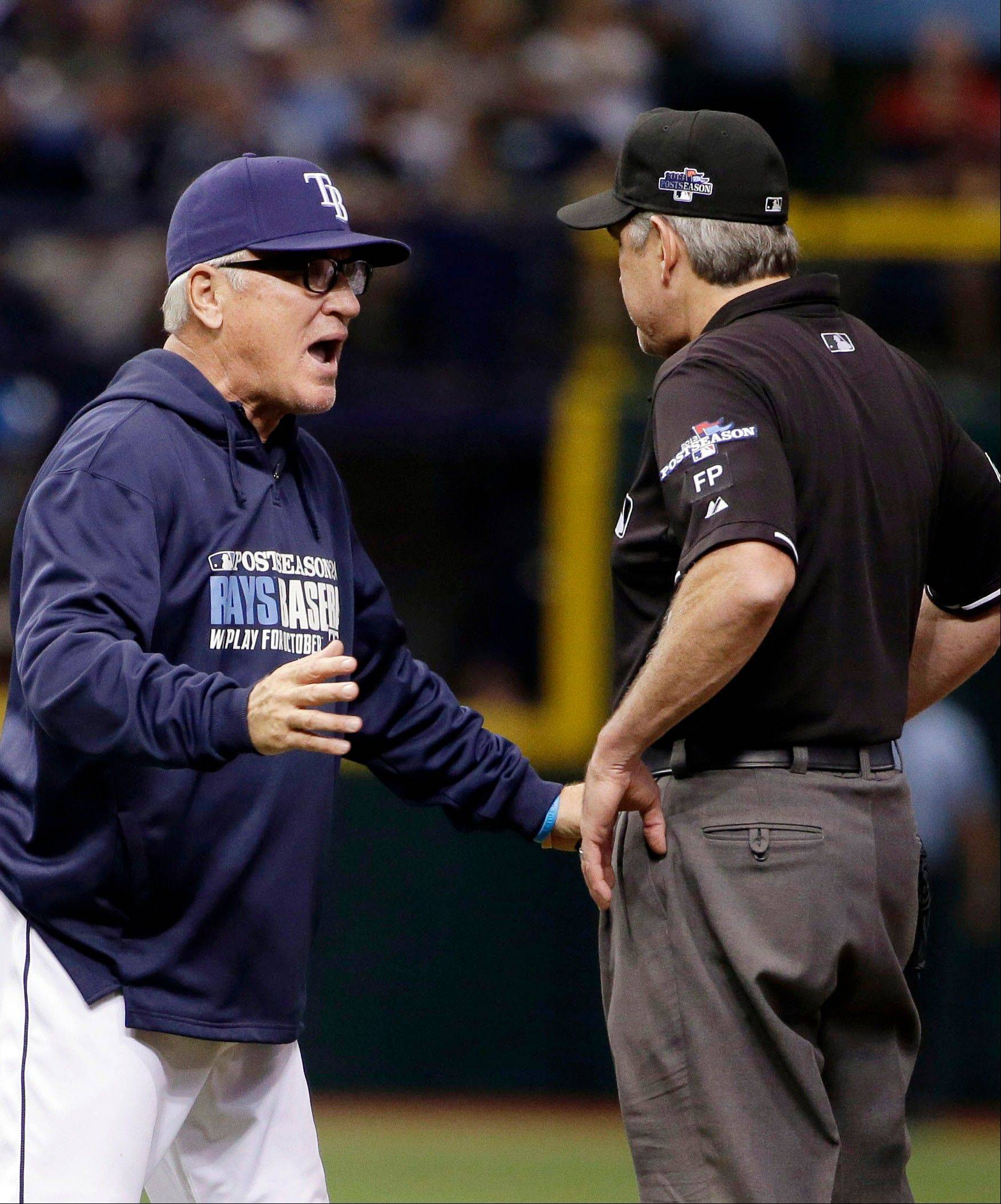 Tampa Bay Rays manager Joe Maddon, left, argues a call with first base umpire Paul Emmel in the eighth inning Monday.
