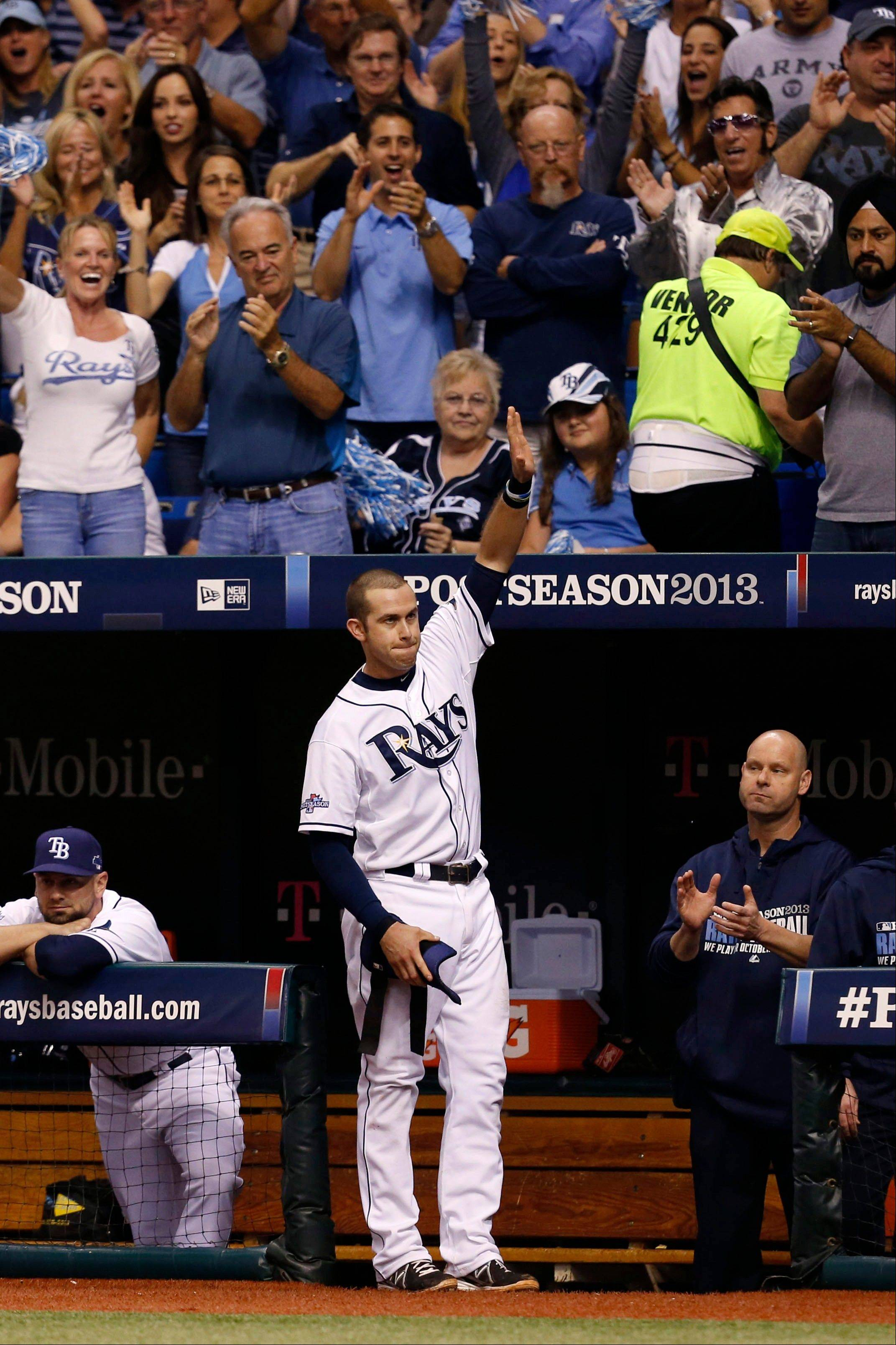 The Rays' Evan Longoria waves to the home crowd after hitting a three-run home run in the fifth inning Monday in Game 3 of an American League Division Series against the Boston Red Sox.
