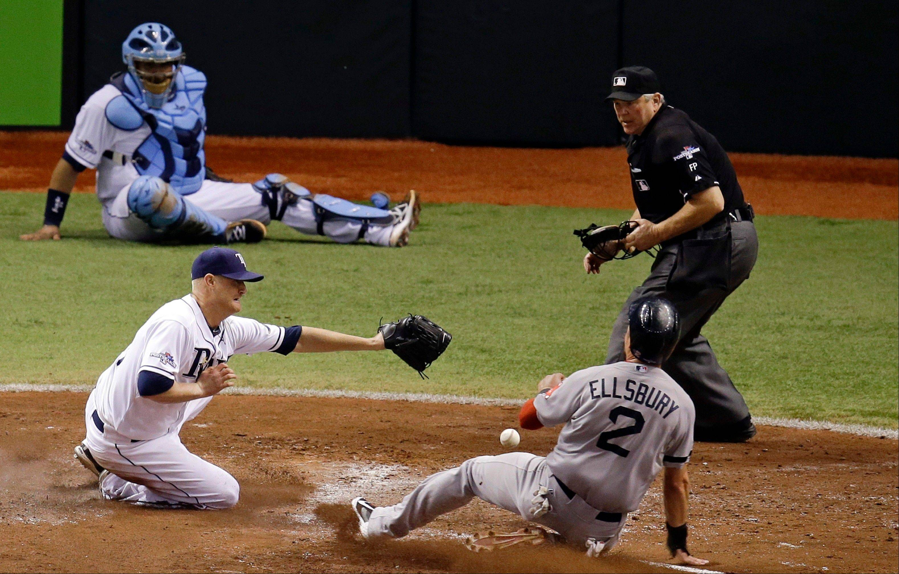 Boston Red Sox center fielder Jacoby Ellsbur slides into home after a wild pitch by Tampa Bay Rays pitcher Alex Cobb during Game 3 of an American League Division Series in St. Petersburg, Fla.