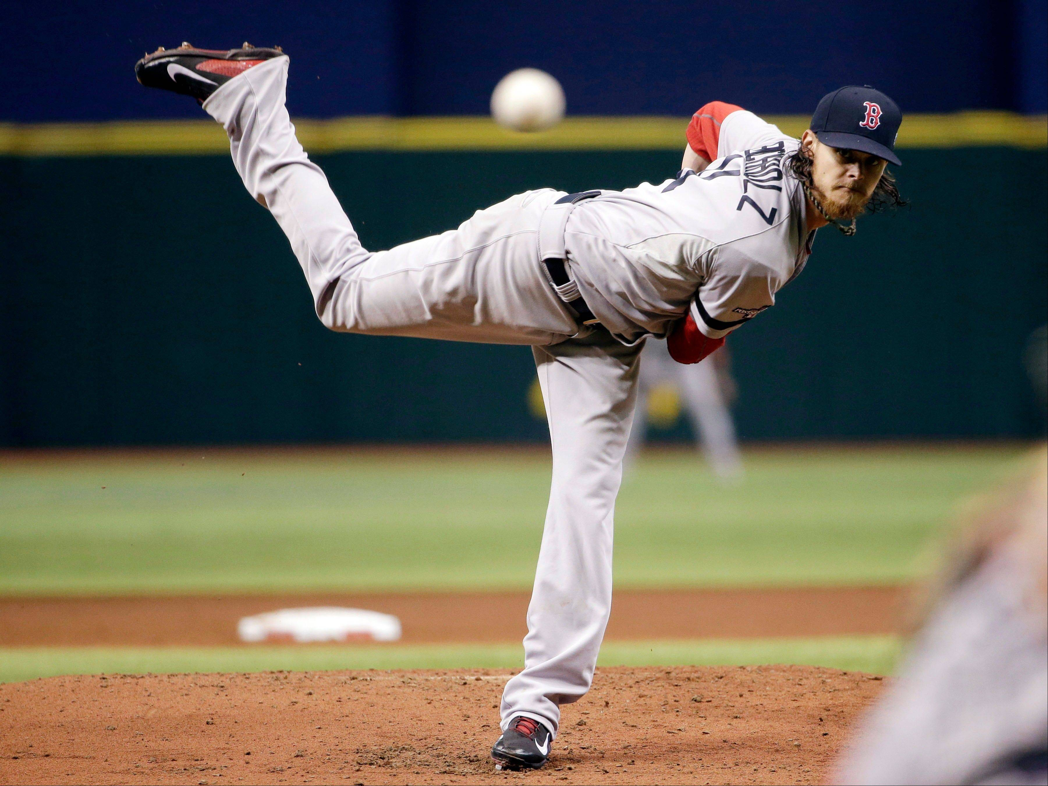 Boston Red Sox starting pitcher Clay Buchholz watches his pitch in the first inning Monday in Game 3 of an American League Division Series against the Tampa Bay Rays.