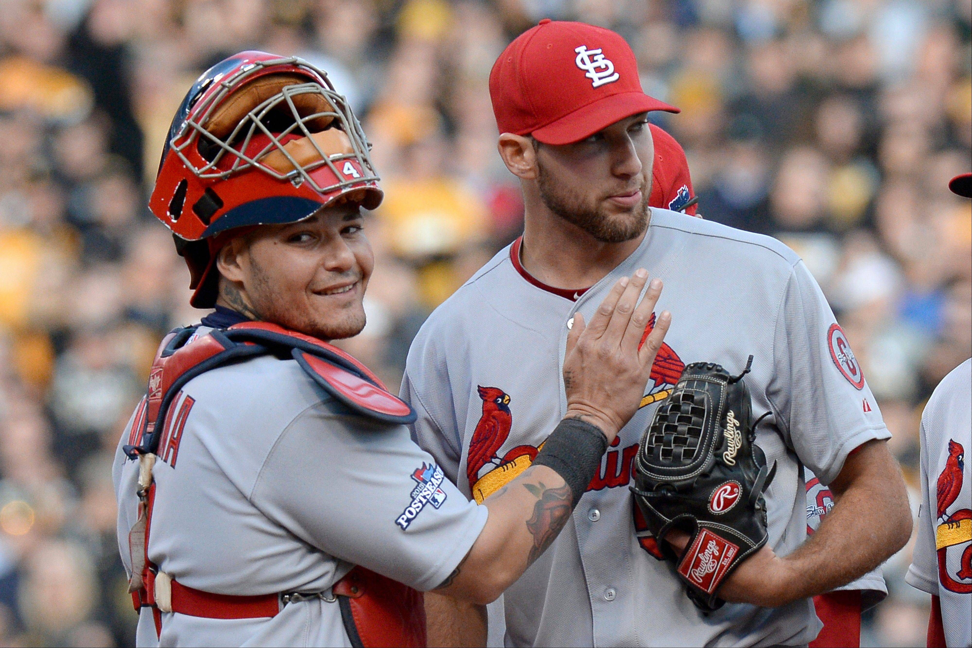 St. Louis Cardinals catcher Yadier Molina, left, pats starting pitcher Michael Wacha right before he was lifted from the game in the eighth inning Monday in Game 4 of a National League Division Series against the Pittsburgh Pirates. Wacha had a no-hitter going until the Pirates' Pedro Alvarez hit a home run in that inning.