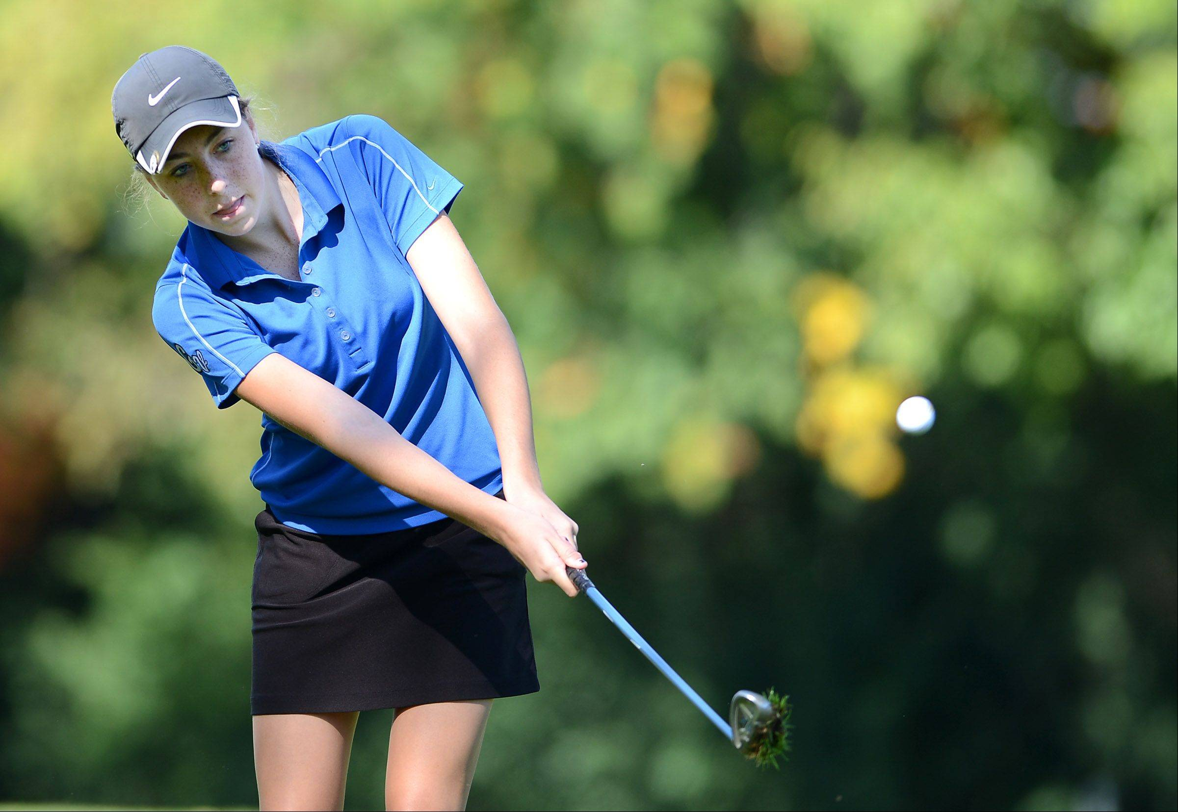 Geneva's Nicole Hassels pitches onto the green during Monday's Upstate Eight girls golf conference meet in West Chicago.