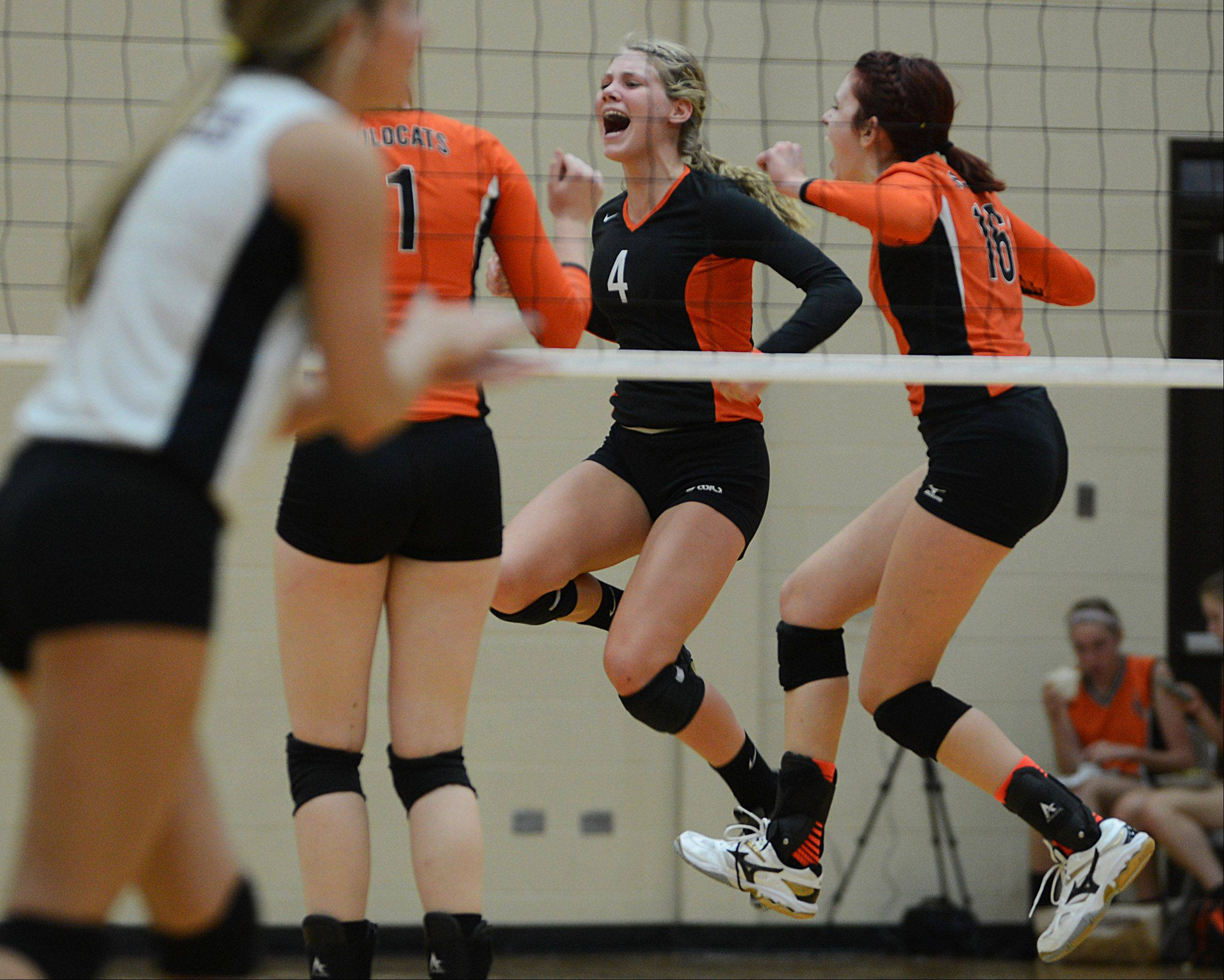 Libertyville's Morgan O'Brien (4) and Rhiannon Prentiss (16) celebrate a point on their way to defeating Zion-Benton in the first game of Monday's volleyball match in Libertyville.