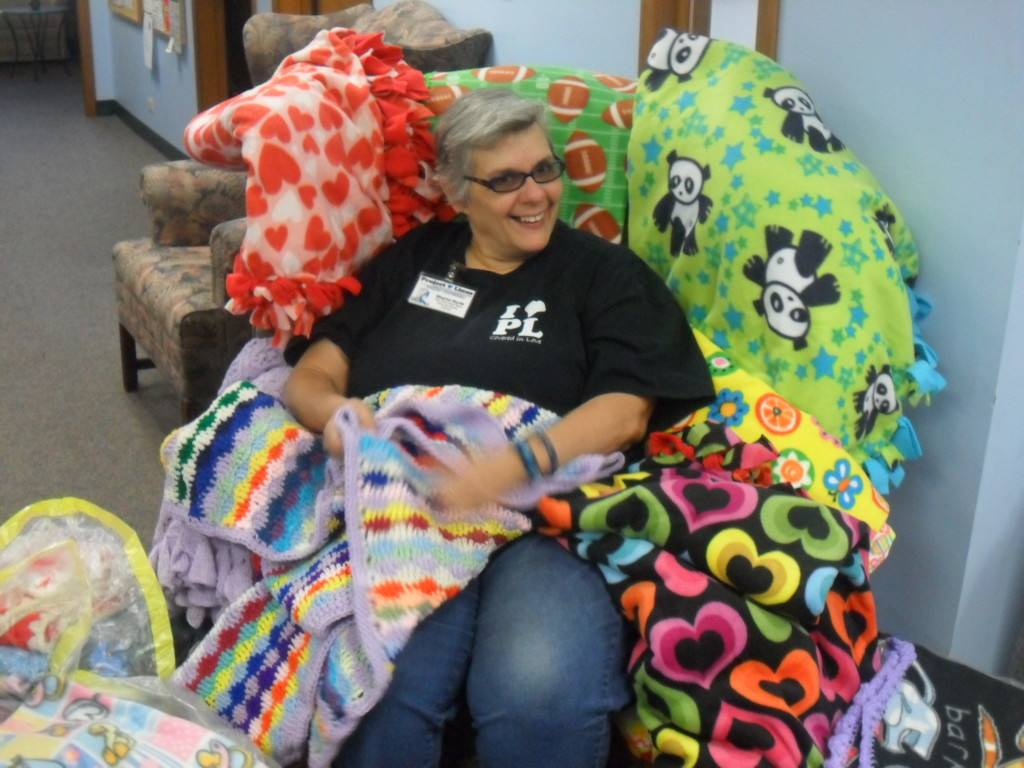 Sharon Kurth of the Oak Park chapter of Project Linus with donated blankets.