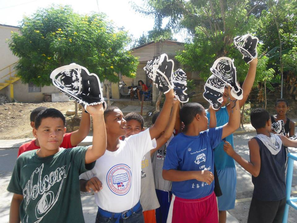 Children of the Dominican were thrilled to receive baseball mitts provided by Northbrook-based youth charity Gear for Goals during recent mission trip.