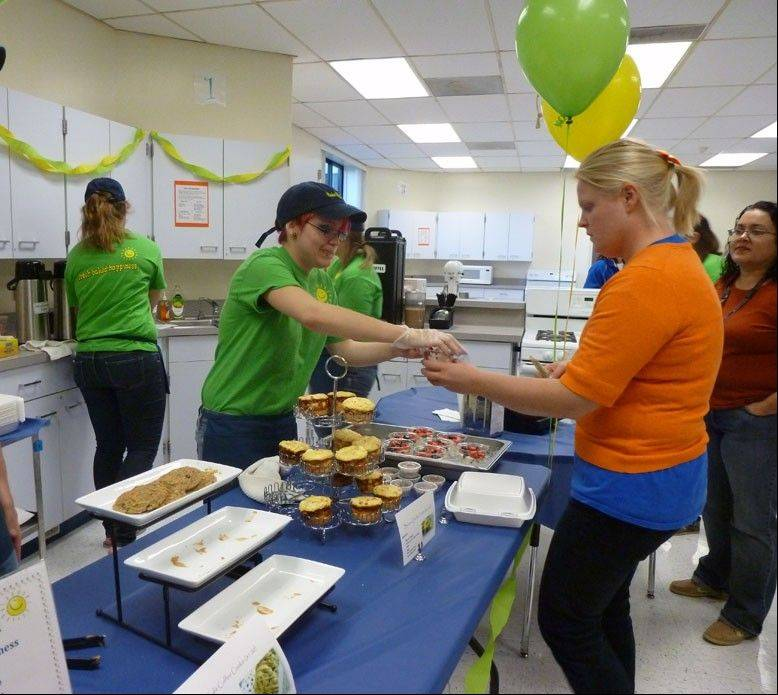 Senior Ashley Goodrich serves customers during the Bake My Day grand opening.