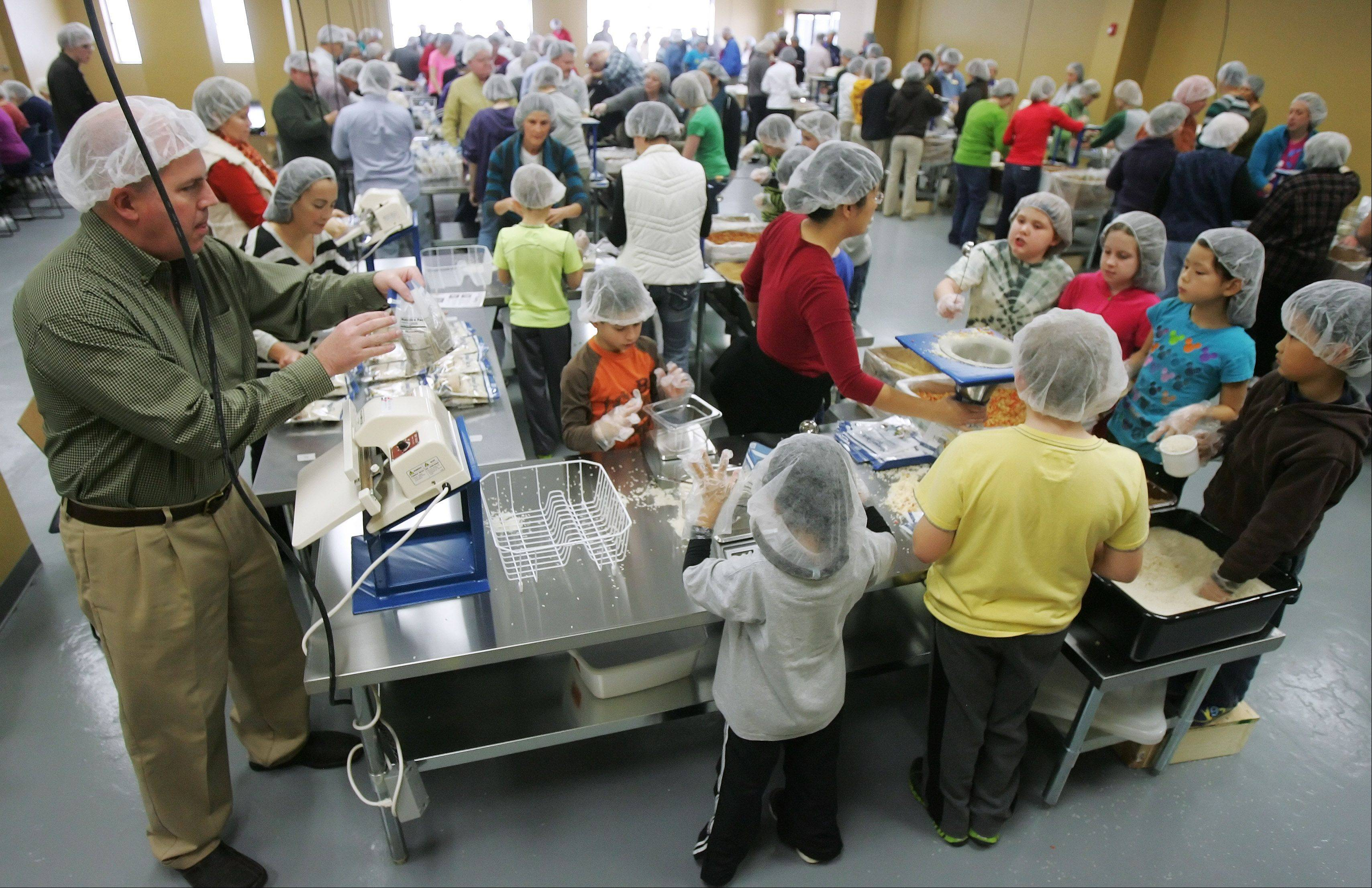 Volunteers work during the inaugural meal-packing session at Feed My Starving Children in Libertyville. The organization prepares millions of meals annually at the three Chicago area locations in Libertyville, Schaumburg and Aurora.